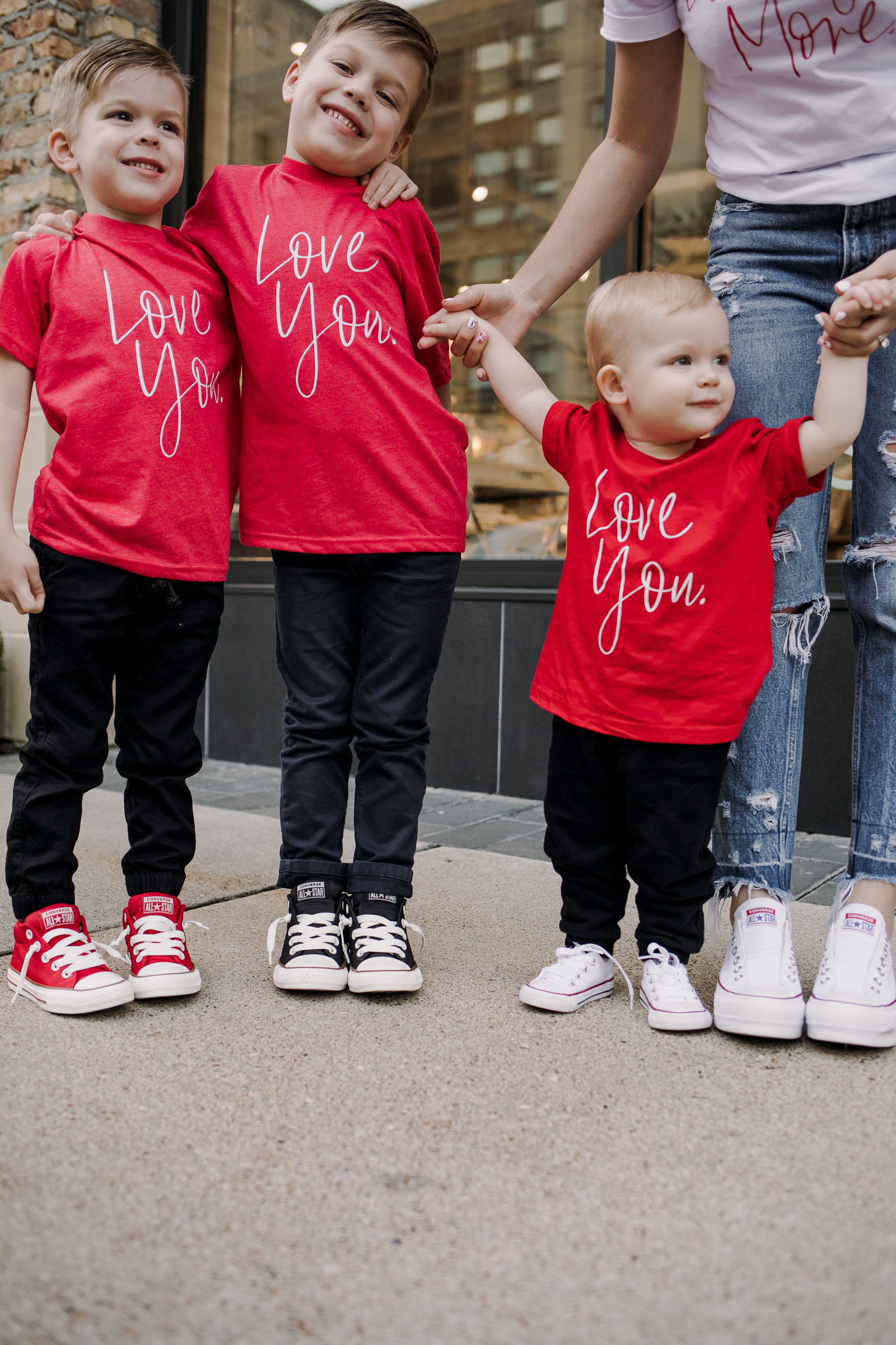 Houston fashion blogger Uptown with Elly Brown wears matching converse with her sons for a mommy and son matching outfit
