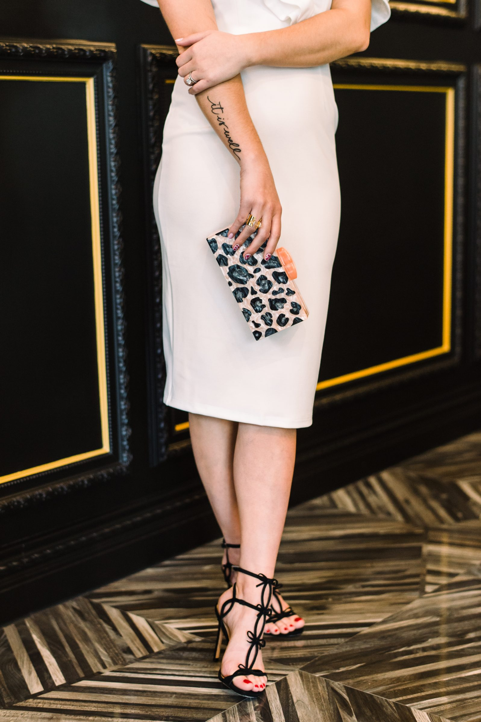 Houston fashion blogger Uptown with Elly Brown wears a Schutz Shoes bow sandals