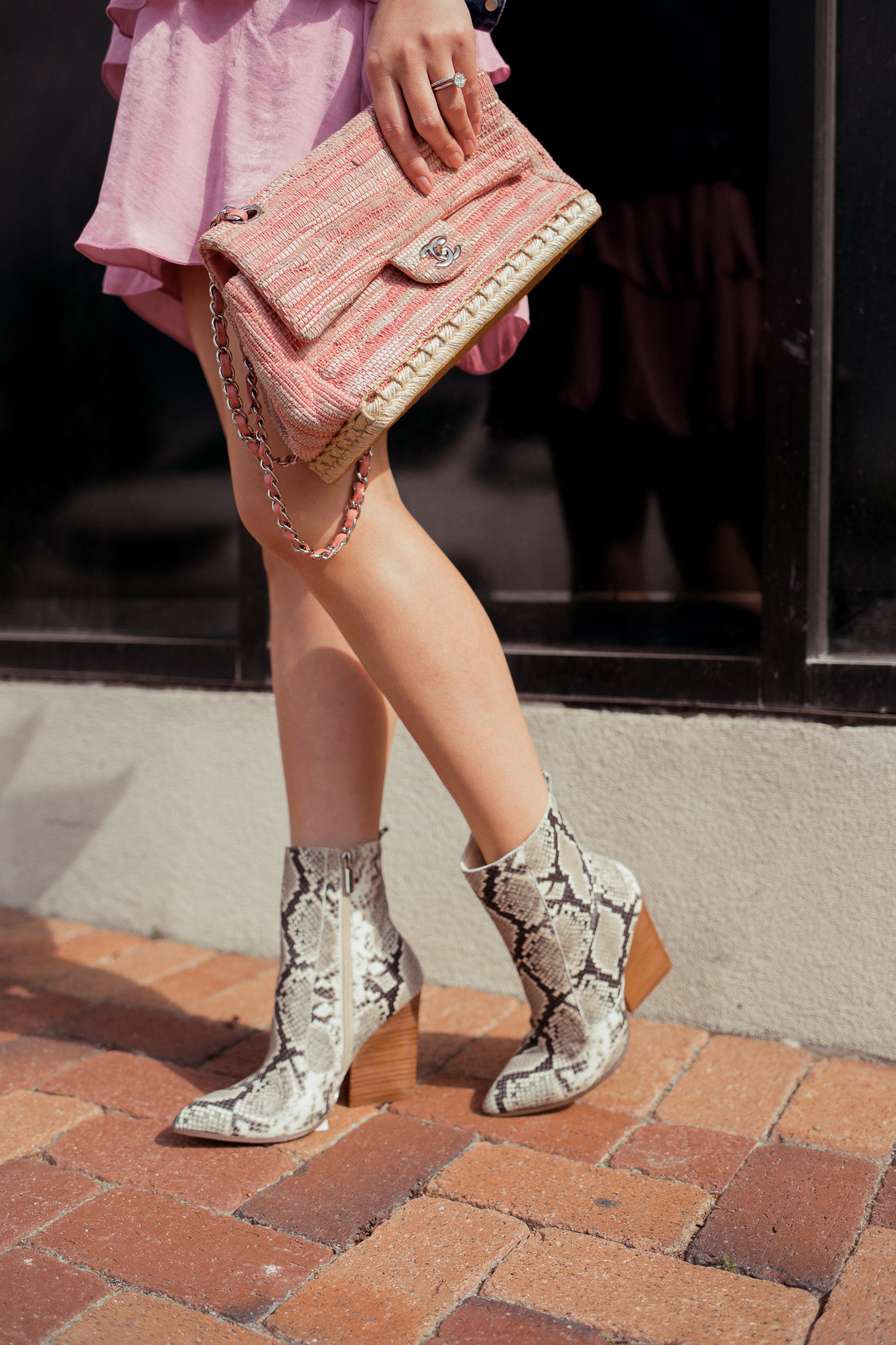 Houston fashion blogger Elly Brown wears a snake print booties for spring