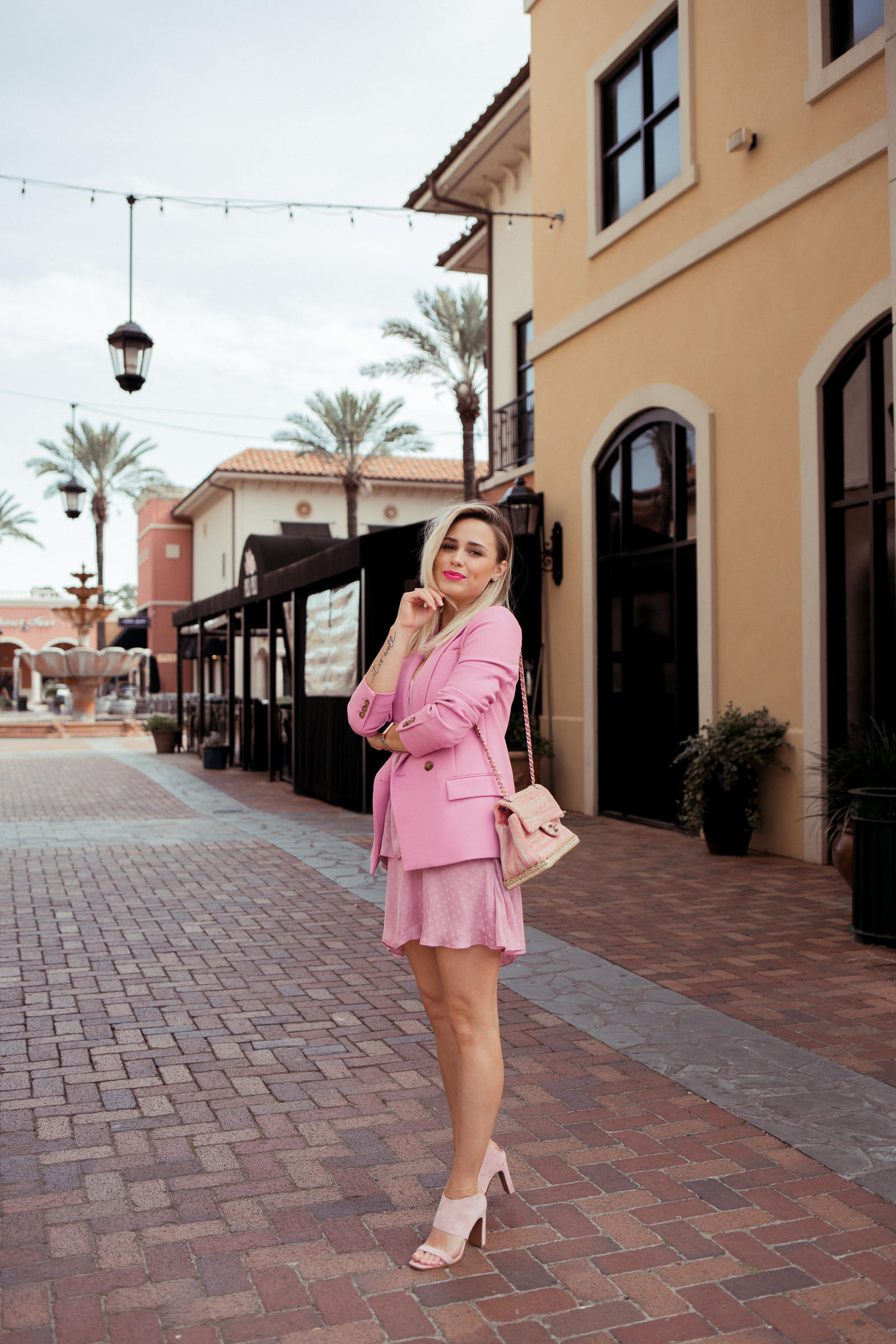 Houston fashion blogger Elly Brown wears a monochromatic pink outfit for spring