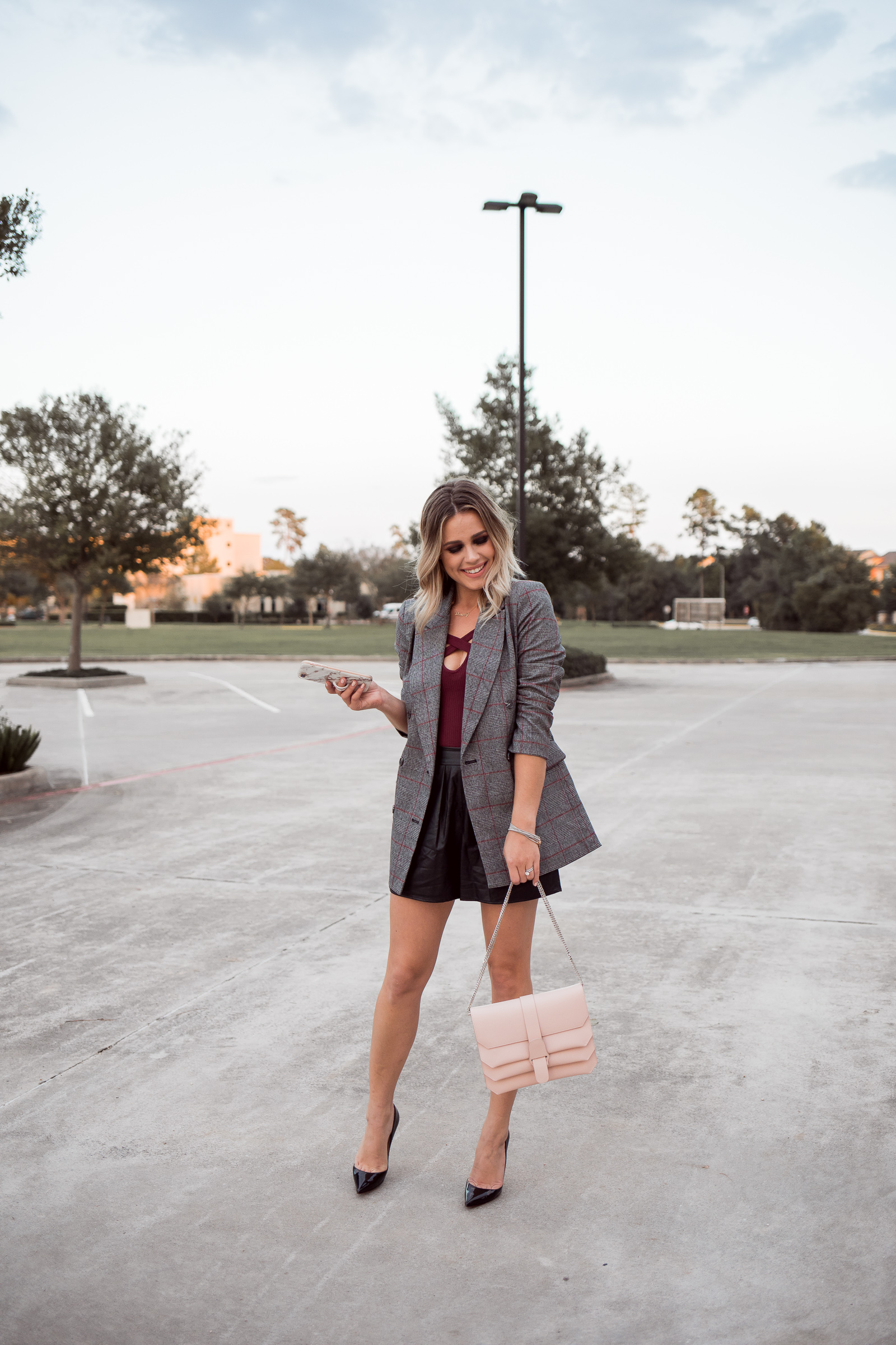 Looking for ideas on How To Wear A Blazer? Houston fashion blogger Uptown with Elly Brown wears her blazer with faux leather shorts