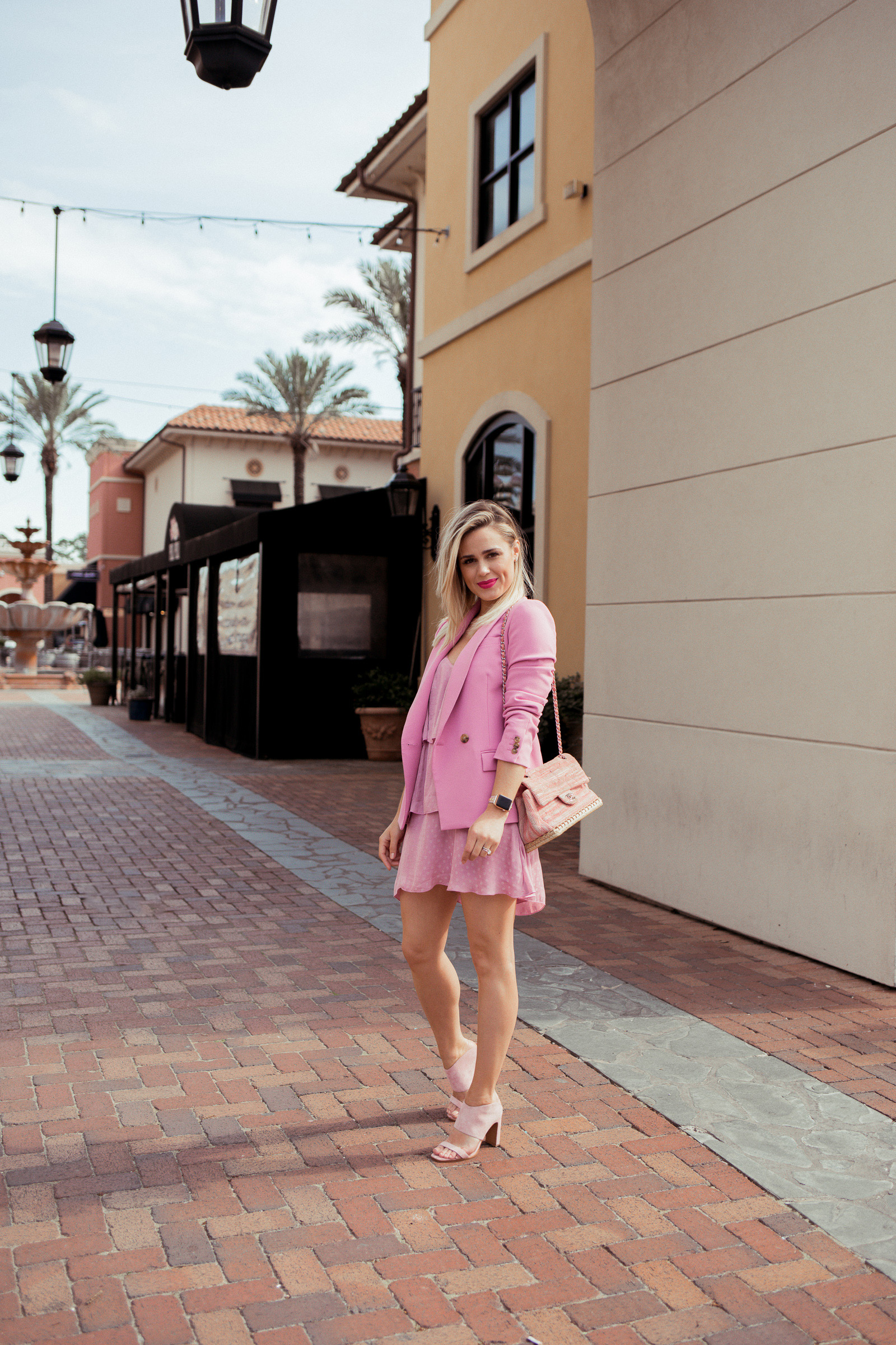 Looking for ideas on How To Wear A Blazer? Houston fashion blogger Uptown with Elly Brown wears her blazer with a ruffle dress