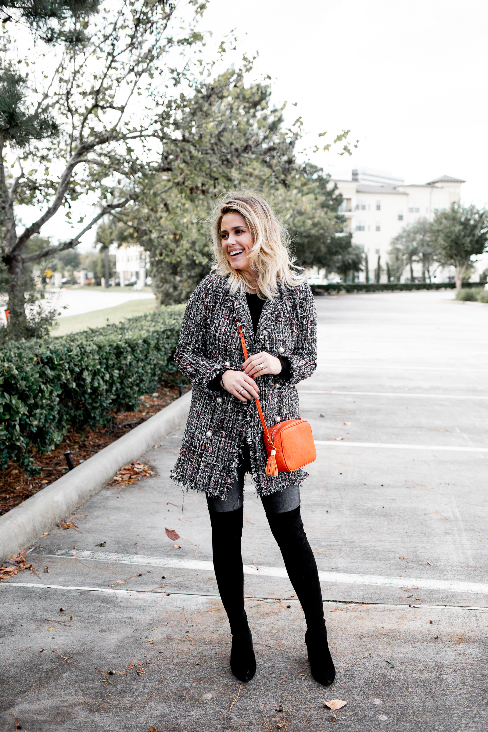 Looking for ideas on How To Wear A Blazer? Houston fashion blogger Uptown with Elly Brown wears her tweed blazer with over the knee boots