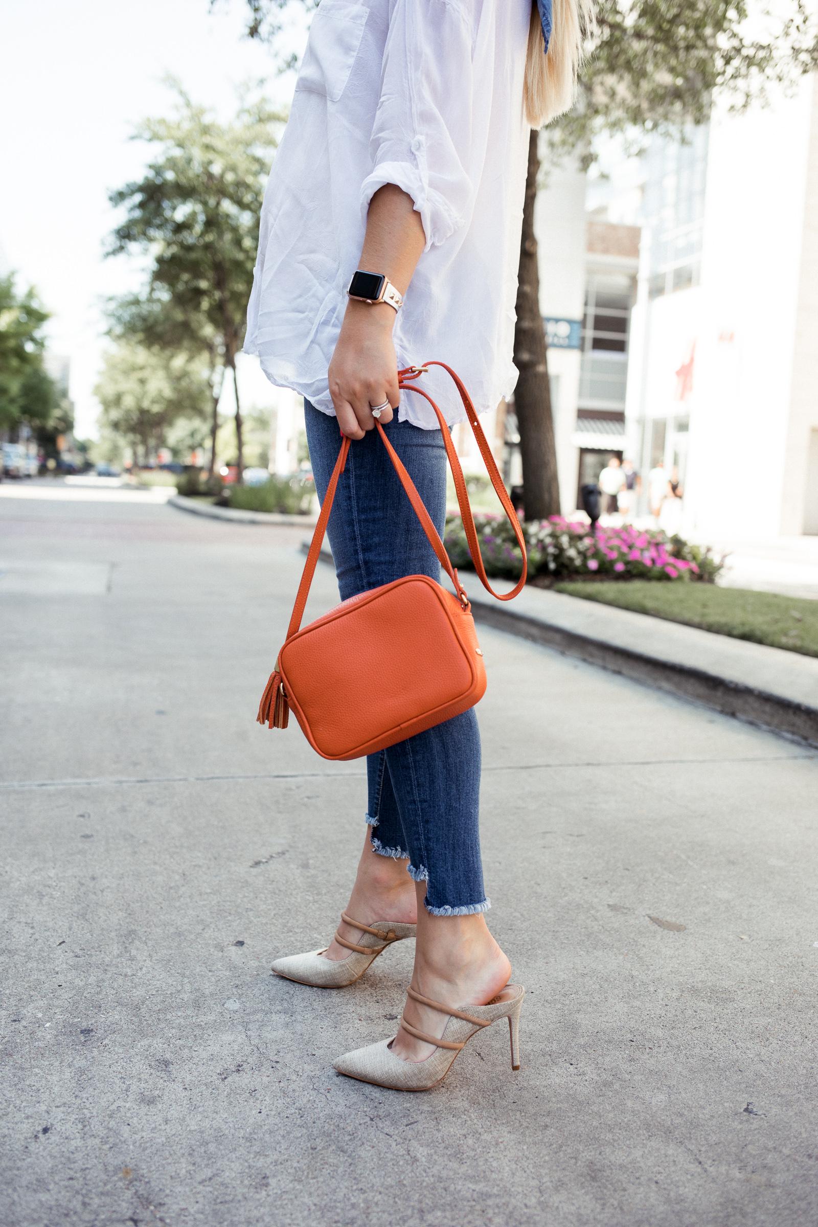 Houston fashion blogger Elly Brown wears a Gigi New York crossbody bag with Schutz nude heels