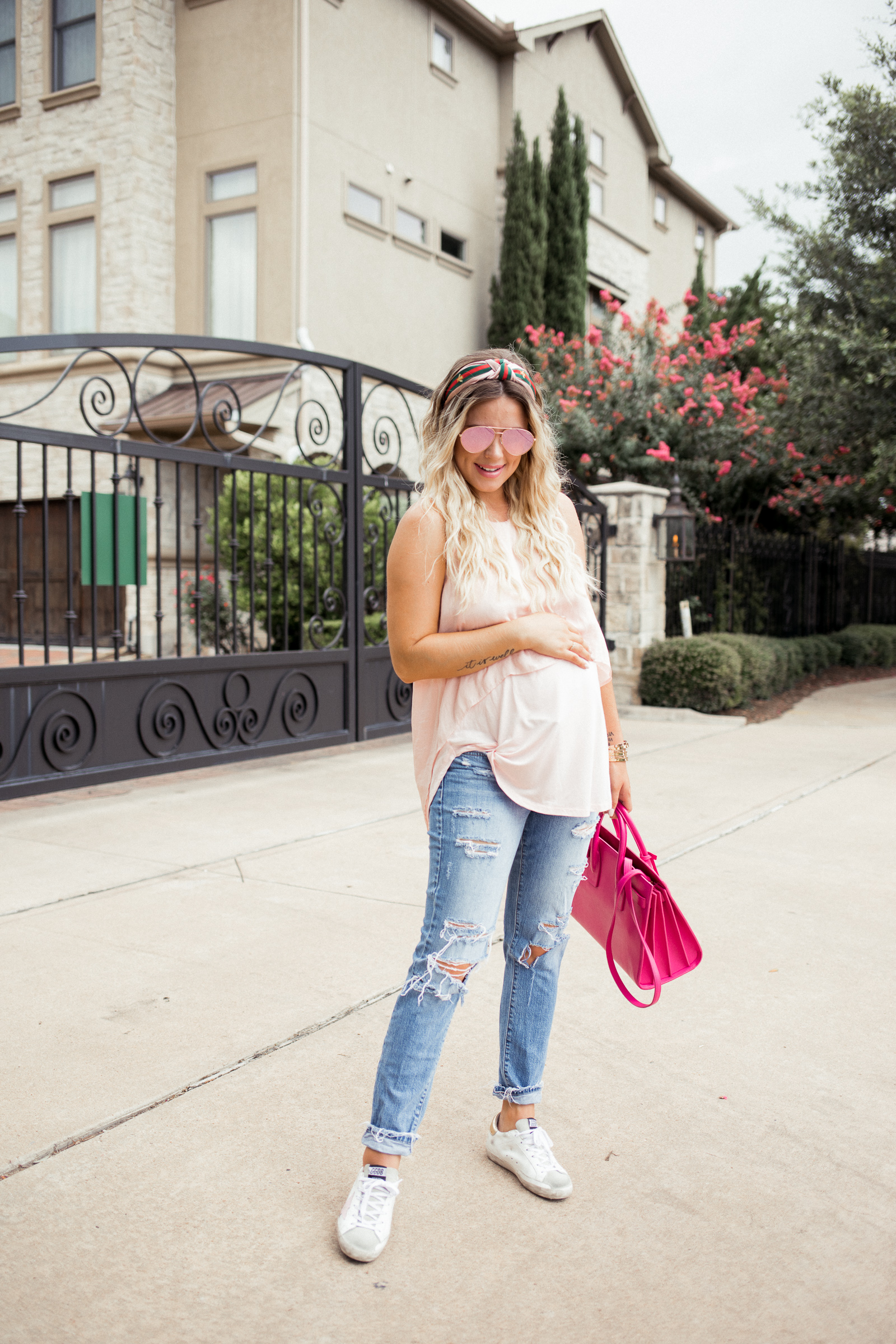 Houston fashion blogger wears golden goose sneakers with distressed denim