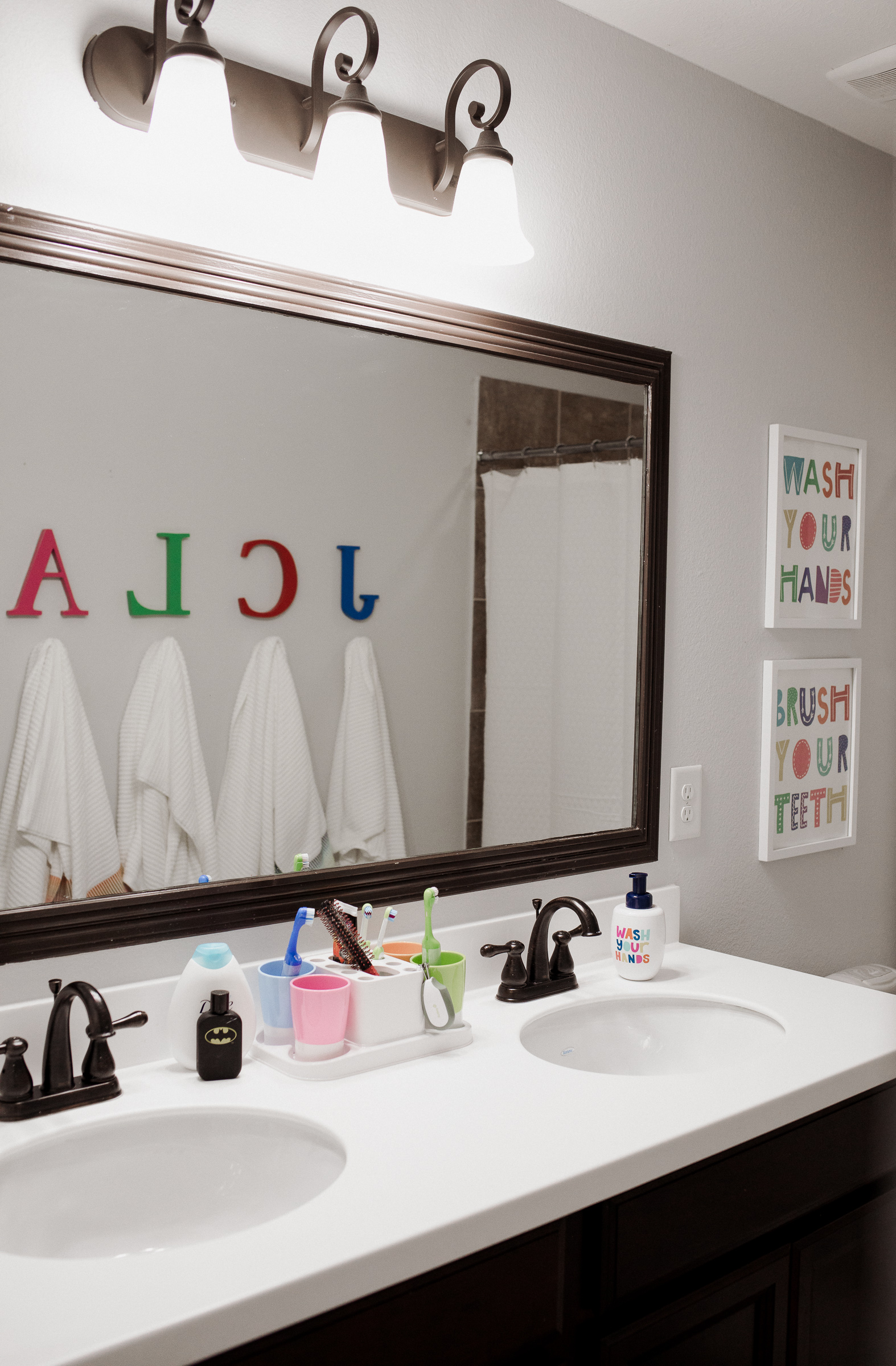 Houston lifestyle blogger Uptown with Elly Brown shares their new simple, and easy Kids bathroom decor