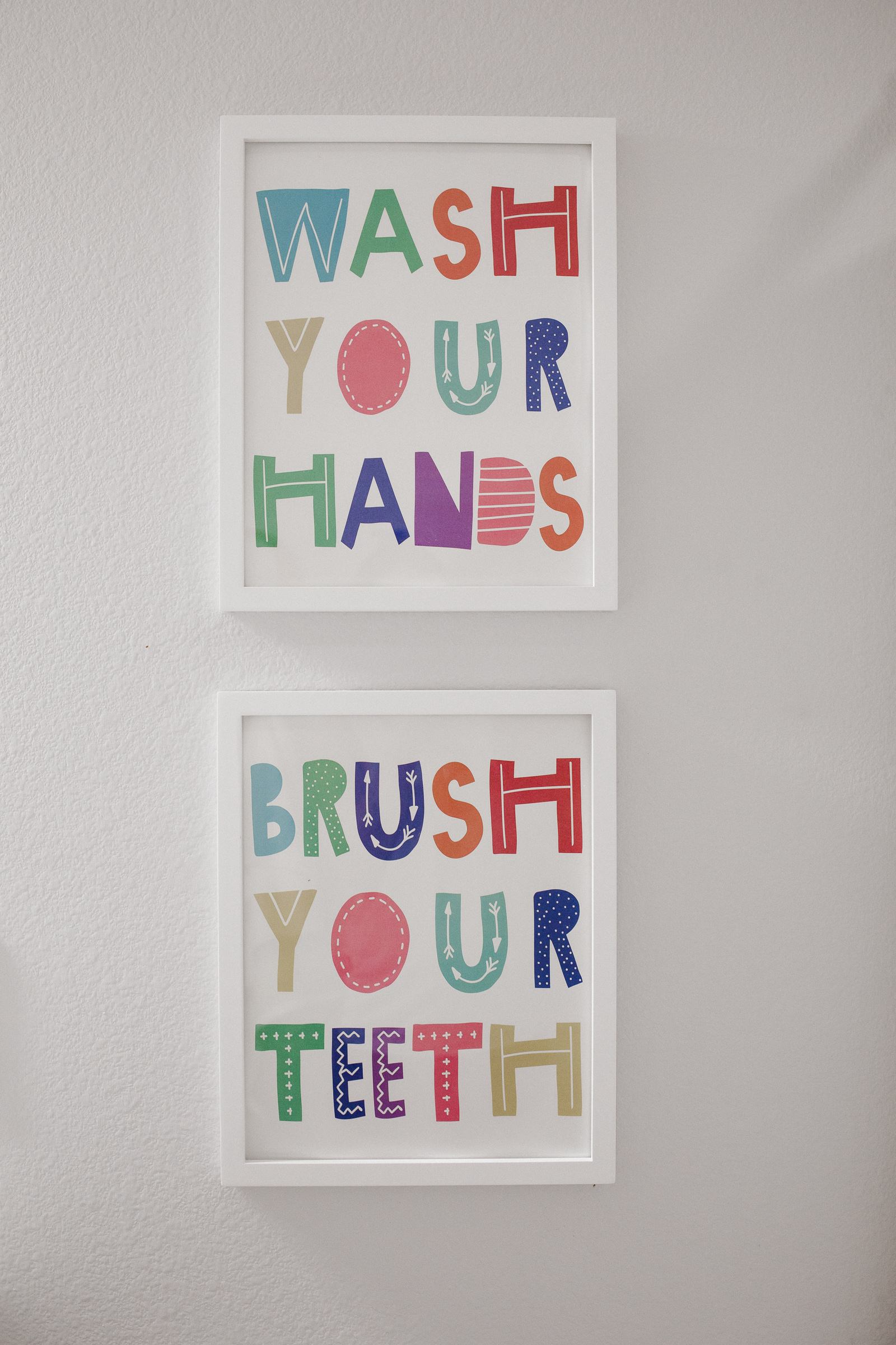 Elly Brown shares her Wash your hands, brush your teeth bathroom canvas prints for her shared bathroom decor