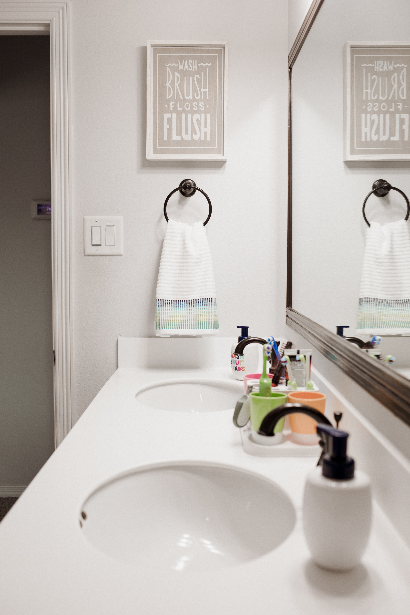Houston lifestyle blogger Uptown with Elly Brown shares their new simple, and easy Kids Shared Bathroom Decor Makeover.
