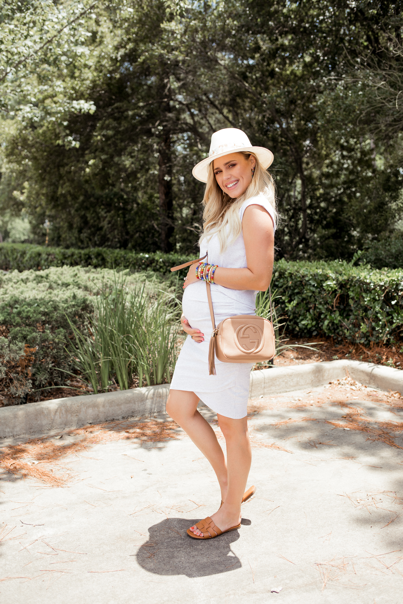 Houston fashion blogger Elly Brown wears Tenth street hat with cognac slides for the summer
