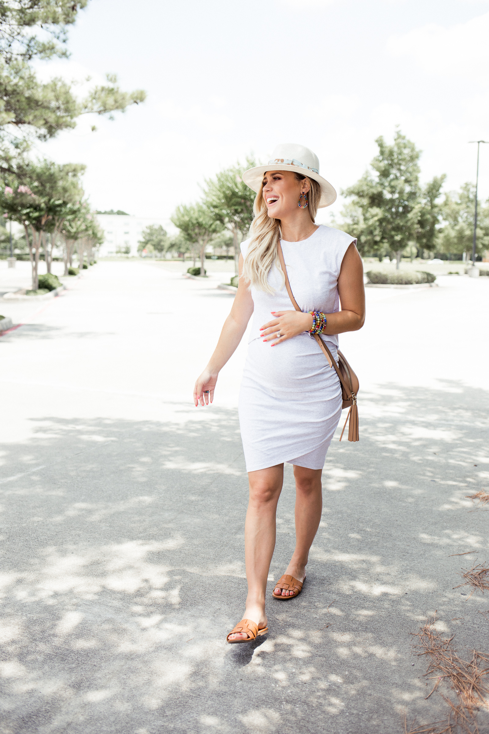 Houston fashion blogger Uptown with Elly Brown wears a bodycon Bae The Label maternity dress