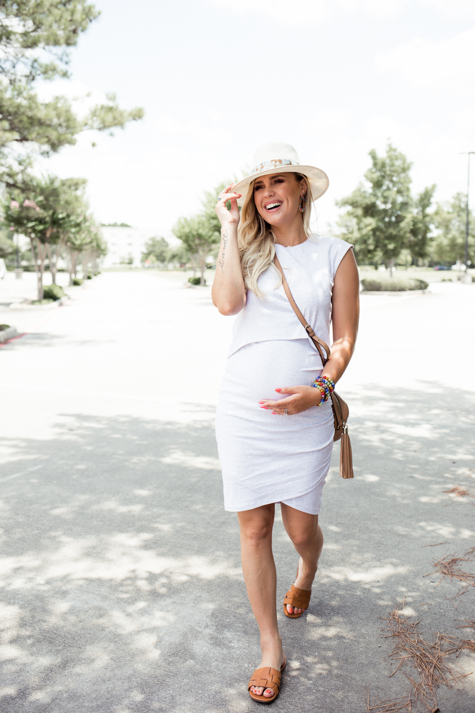 227df8577ea12 Houston fashion blogger Elly Brown wears a Bae The Label maternity dress  for the summer with