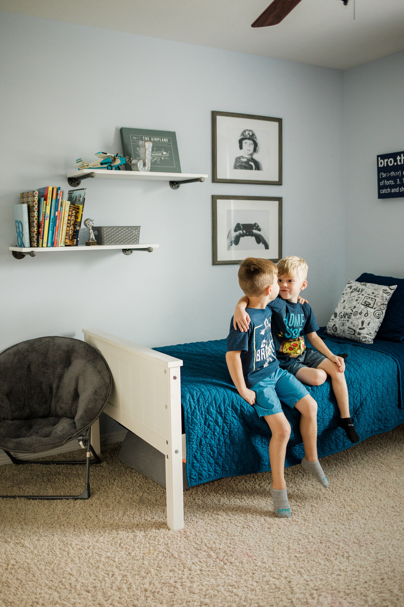 Needing ideas on shared room for boys? Houston lifestyle blogger Elly Brown shares her Irish twins bedroom and how they decorated the space!