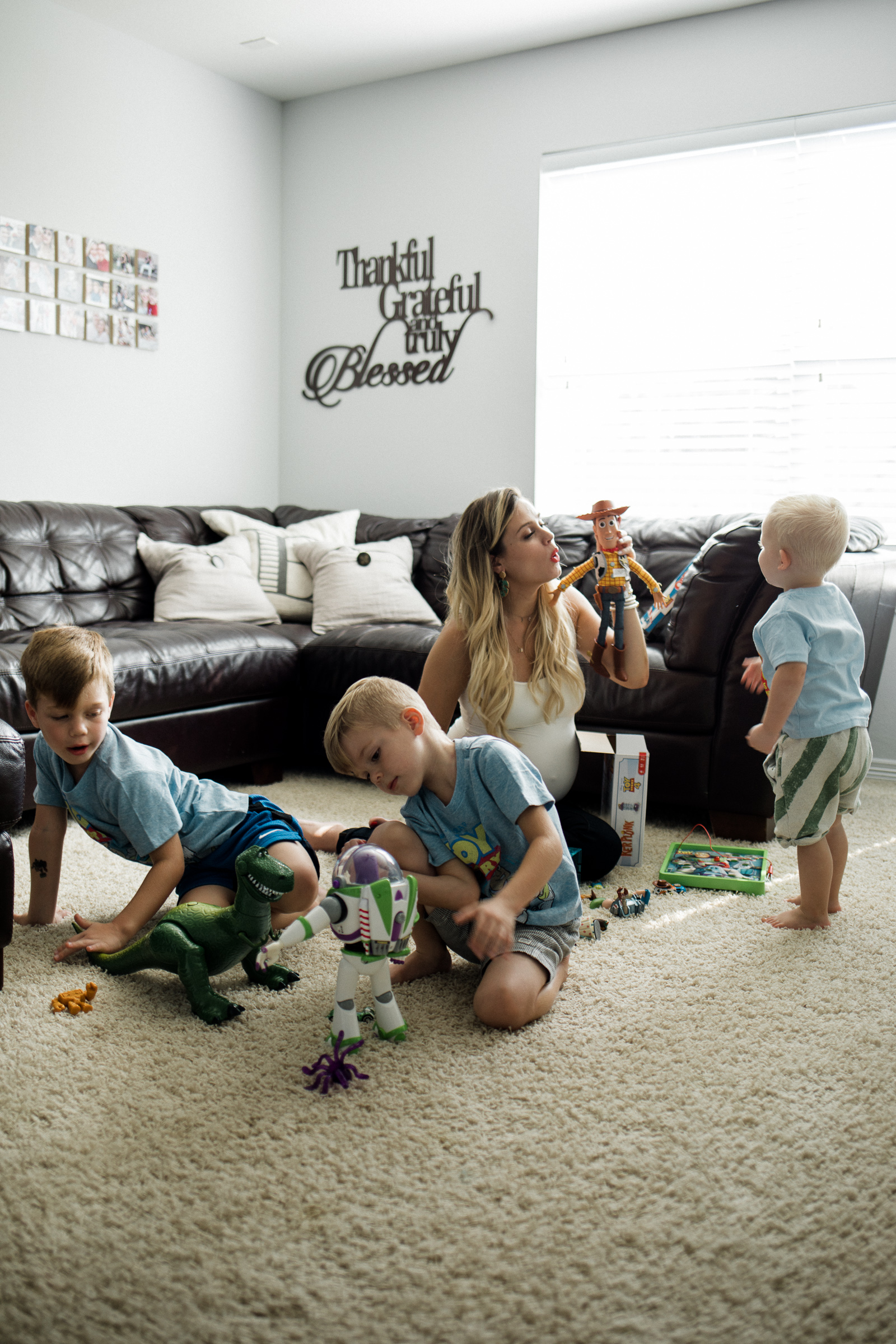 Blogger Uptown with Elly Brown plays on the floor with her kids