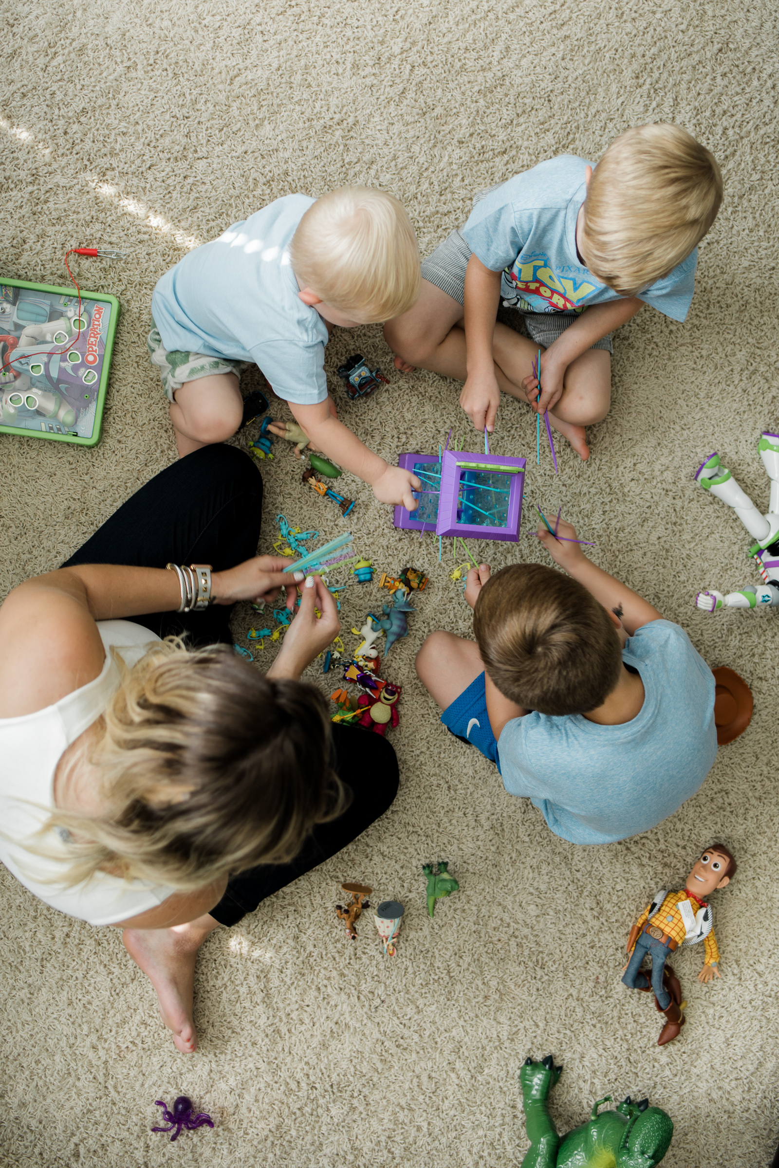 Blogger Uptown with Elly Brown plays on the floor with kids and the Toy Story 4 toys and games!
