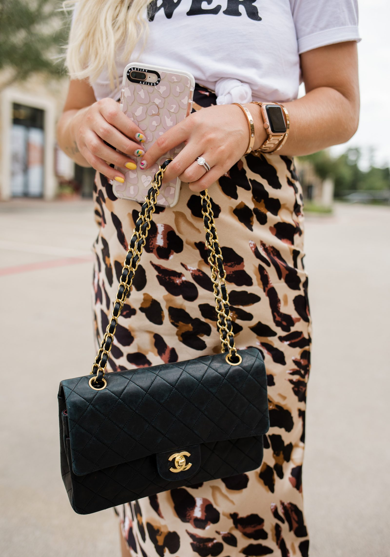 Houston blogger wears a tee over her leopard slip dress paired with a vintage Chanel bag