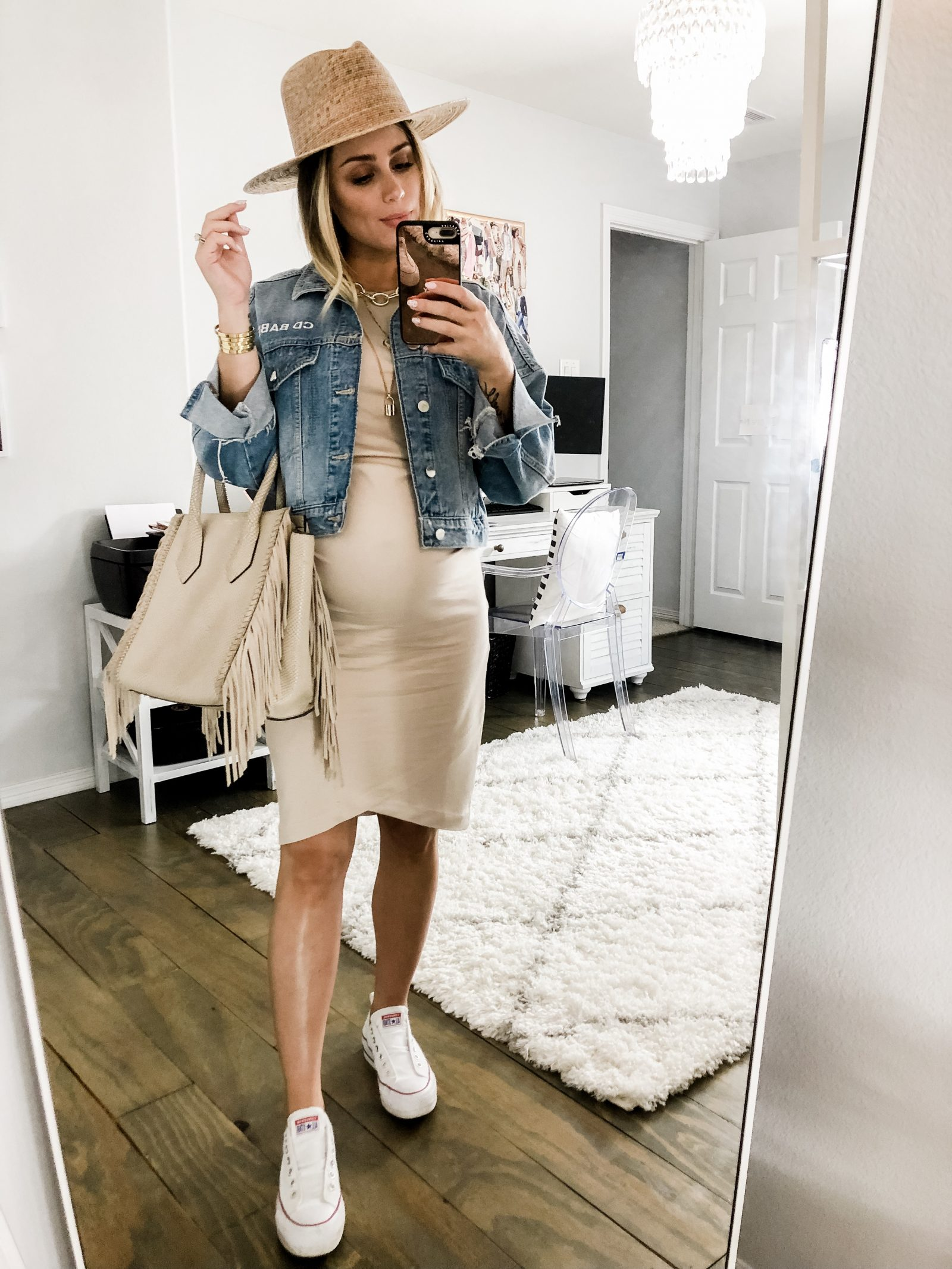 Houston fashion blogger Elly Brown wears her converse sneakers with a bodycon dress and a denim jacket