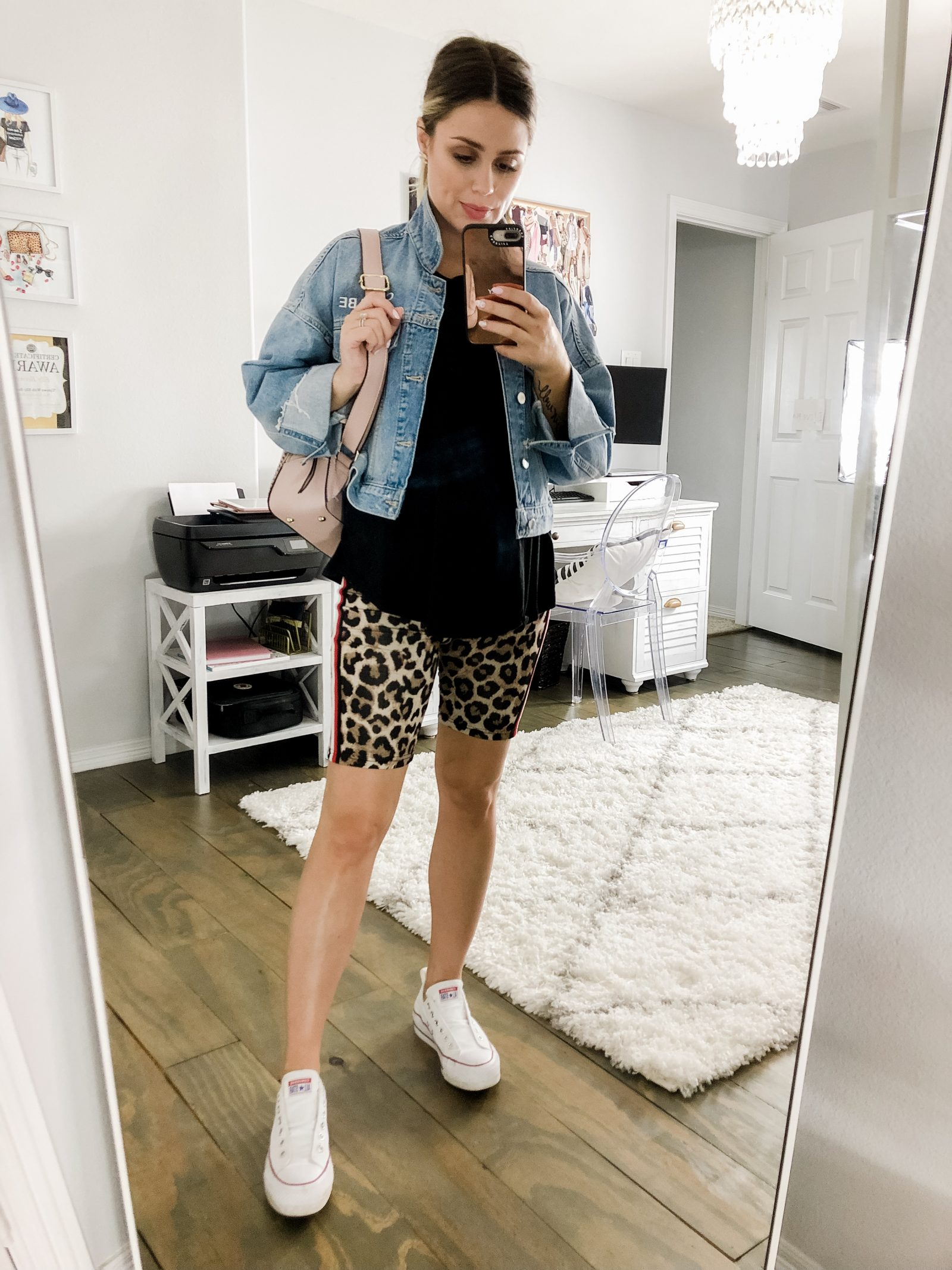 Houston fashion blogger Elly Brown wears her converse sneakers with leopard biker shorts and a denim jacket