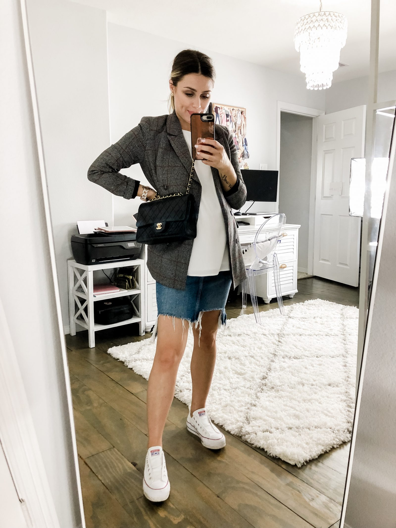 Houston fashion blogger Elly Brown wears her converse sneakers with a denim skirt and oversized blazer