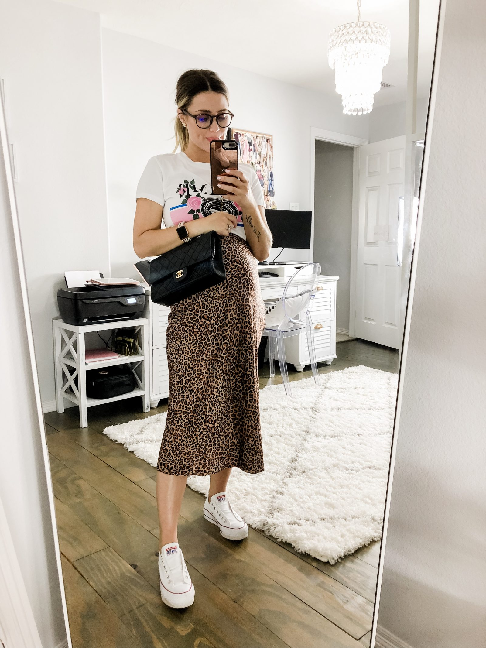 Houston fashion blogger Elly brown wears a bump friendly midi skirt with a graphic tee and converse sneakers