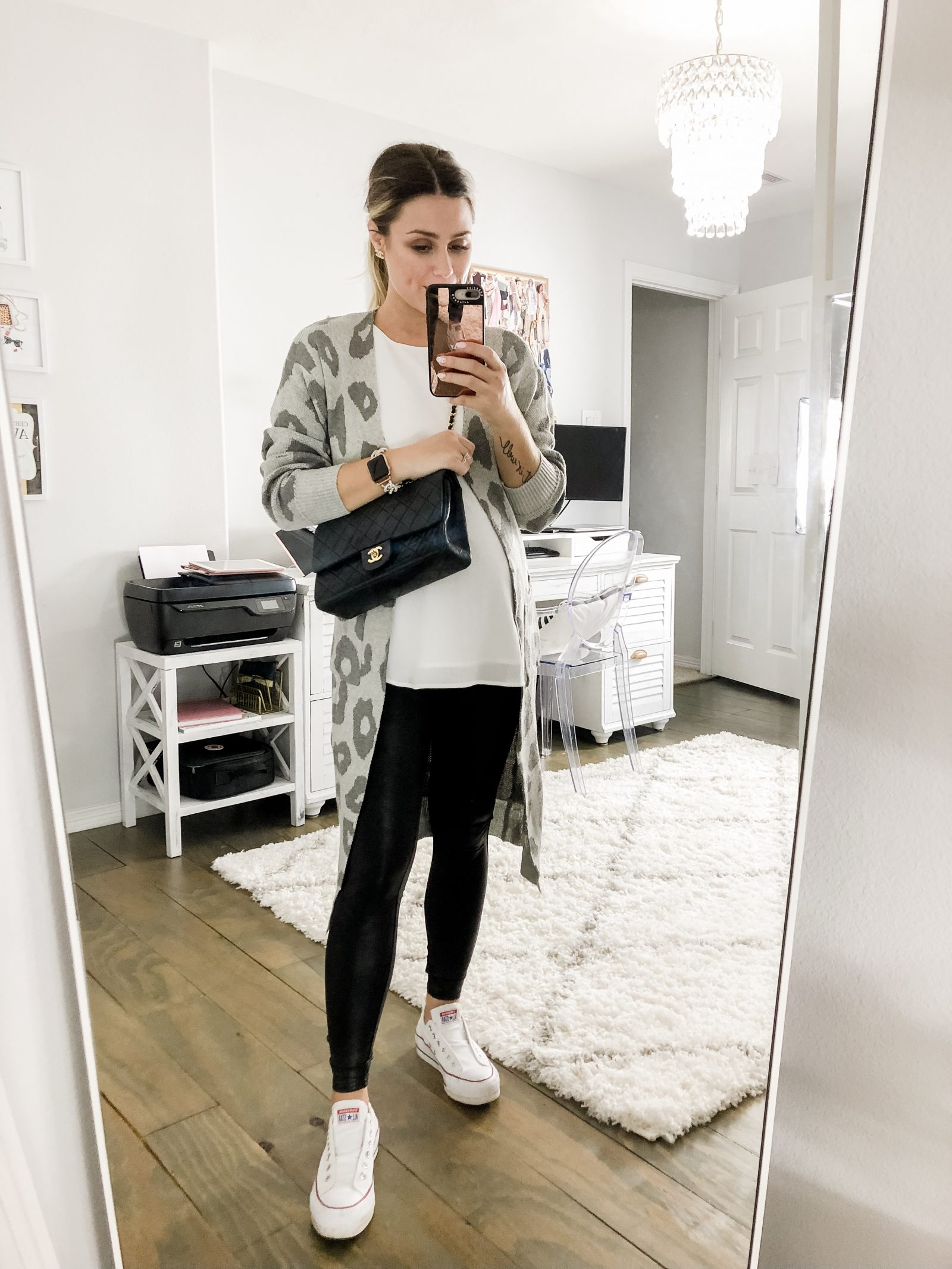 Houston fashion blogger Elly Brown wears her converse sneakers with faux leather leggings and a leopard cardigan