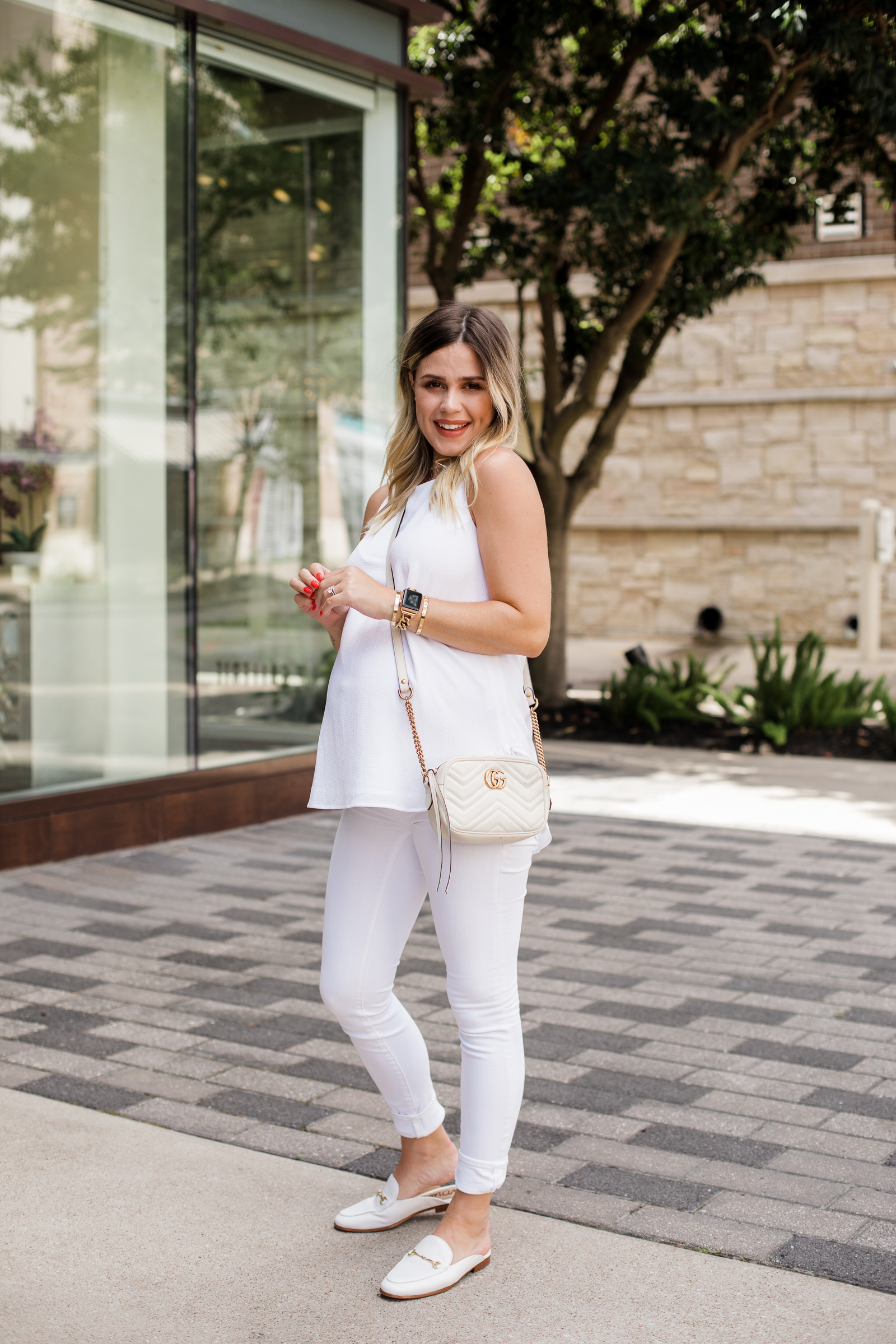 Houston fashion blogger Elly Brown wears a casual all white outfit with white Sam Edelman mules