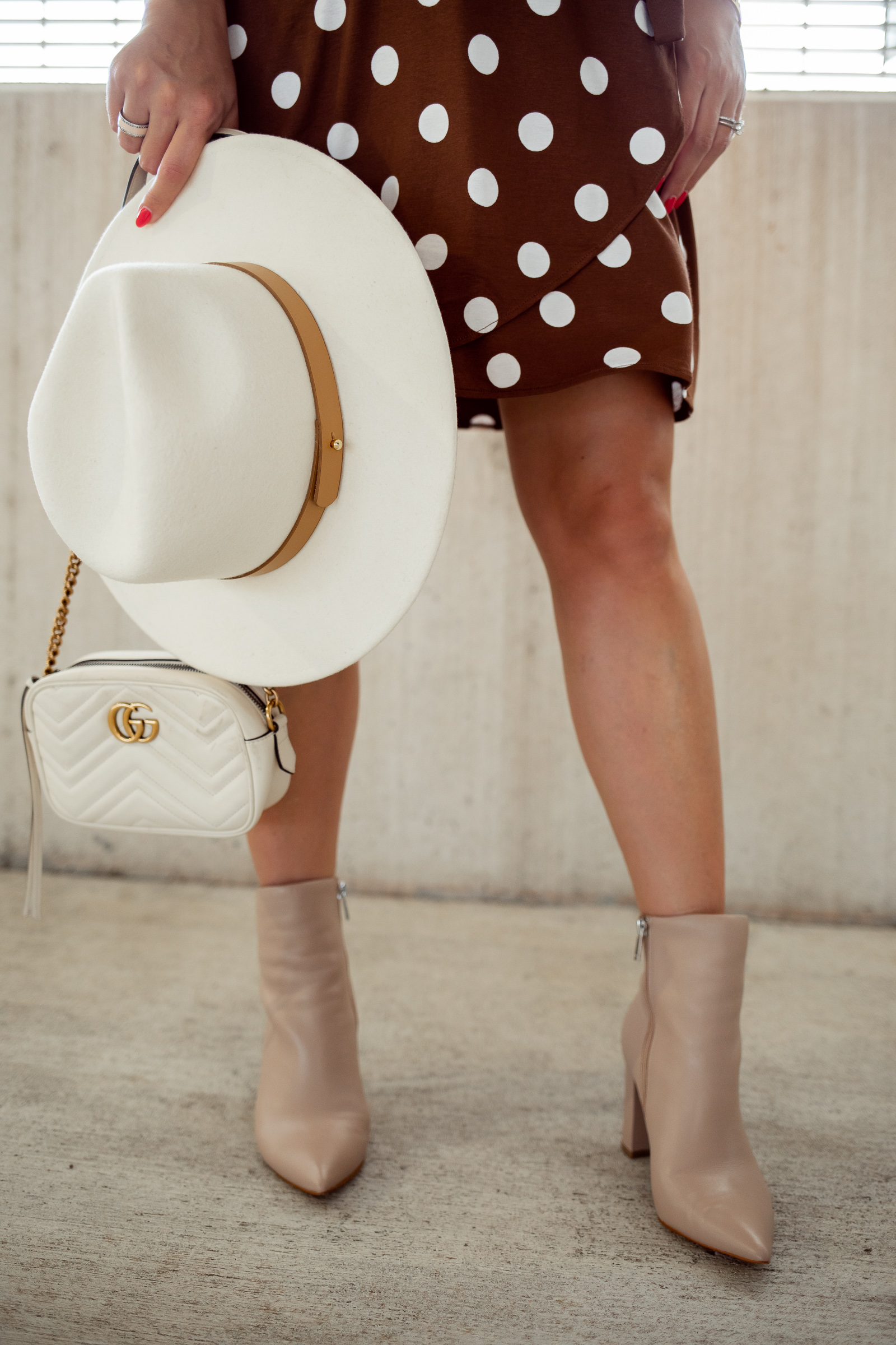 houston fashion blogger Elly Brown wears ankle booties and a wool Lack of Color hat