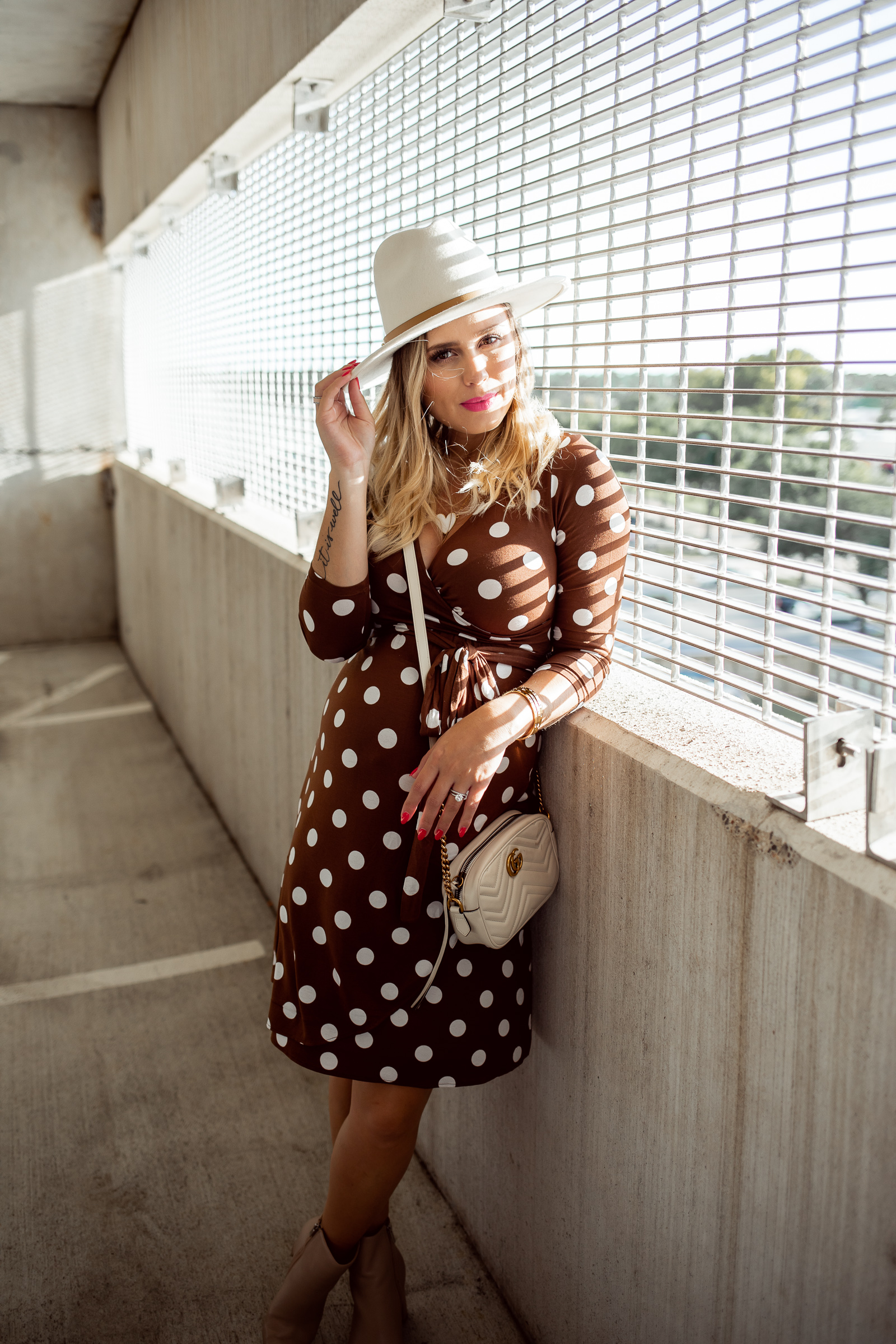 houston fashion blogger Elly Brown wears a lack of color wool hat with a polka dot dress