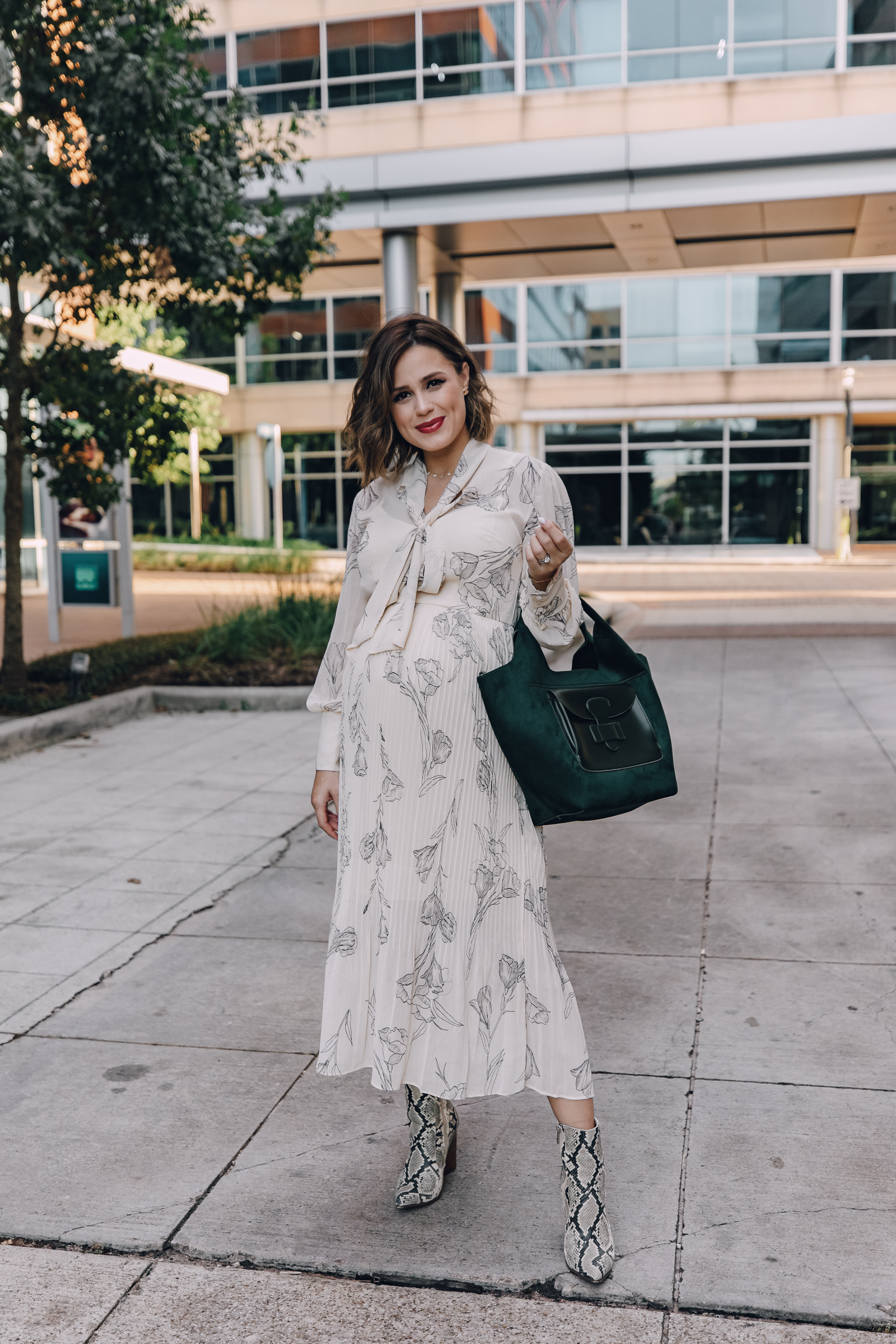 Elly Brown wears a Target pleated fall dress that's under $35 with snake print booties for a fall outfit
