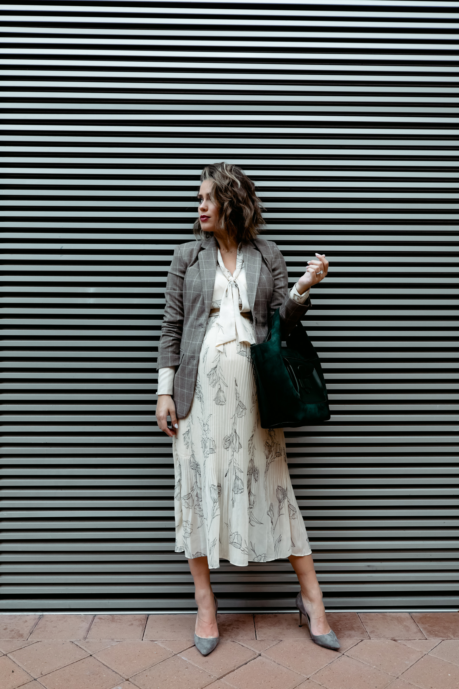 Elly Brown wears a Target pleated fall dress that's under $35 with grey suede heels and a blazer