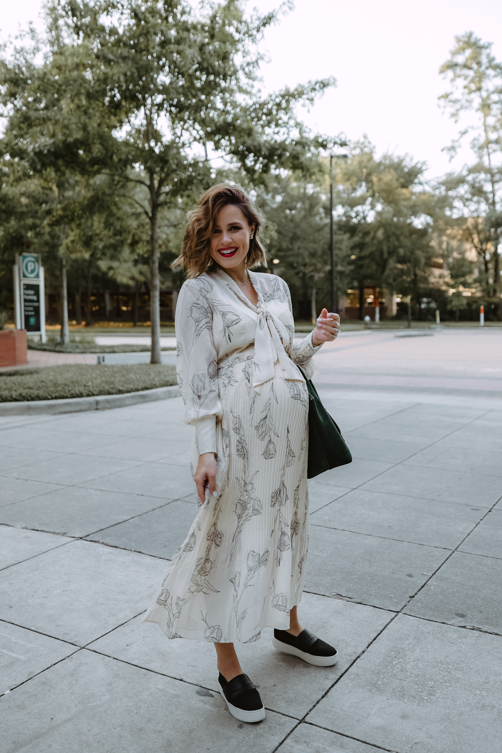 Elly Brown wears a Target pleated fall dress that's under $35 paired with platform sneakers for a casual outfit
