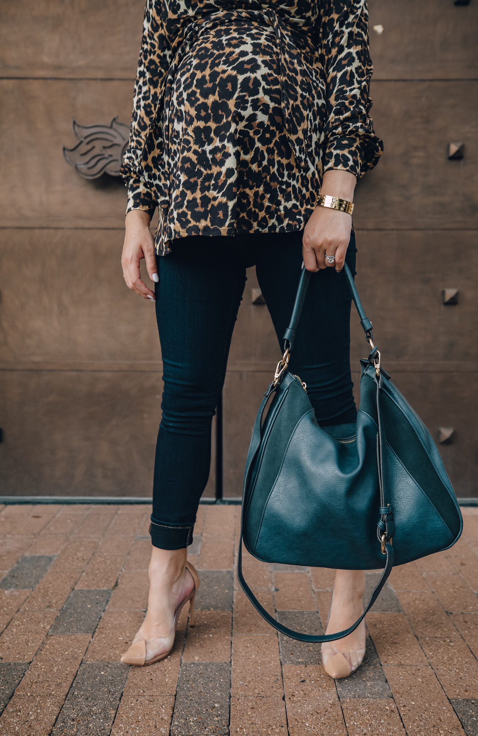 fashion blogger Elly Brown wears Sole Society bag with a leopard top for a fall maternity outfit
