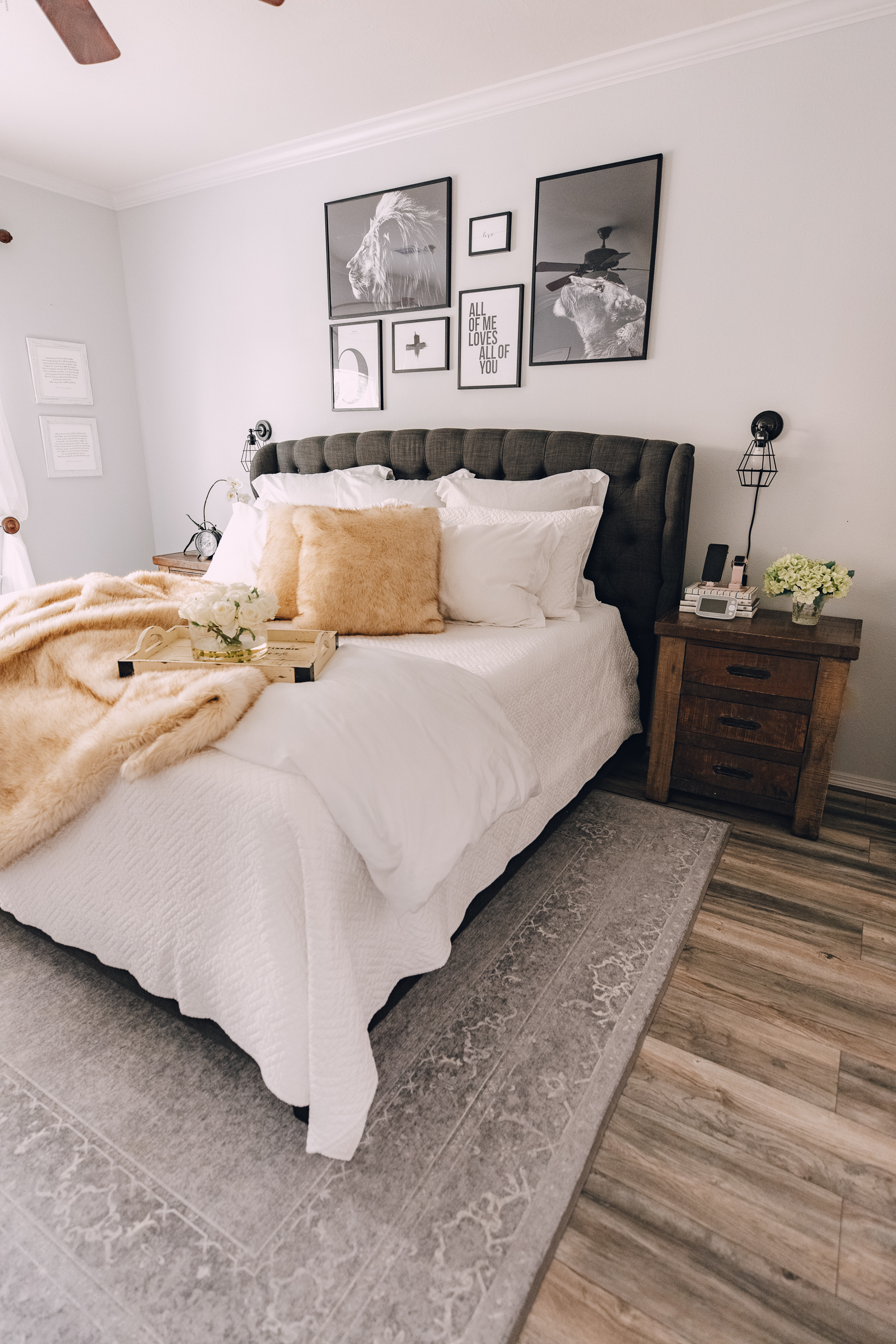 lifestyle blogger Elly Brown shares over the bed wall art in her master bedroom