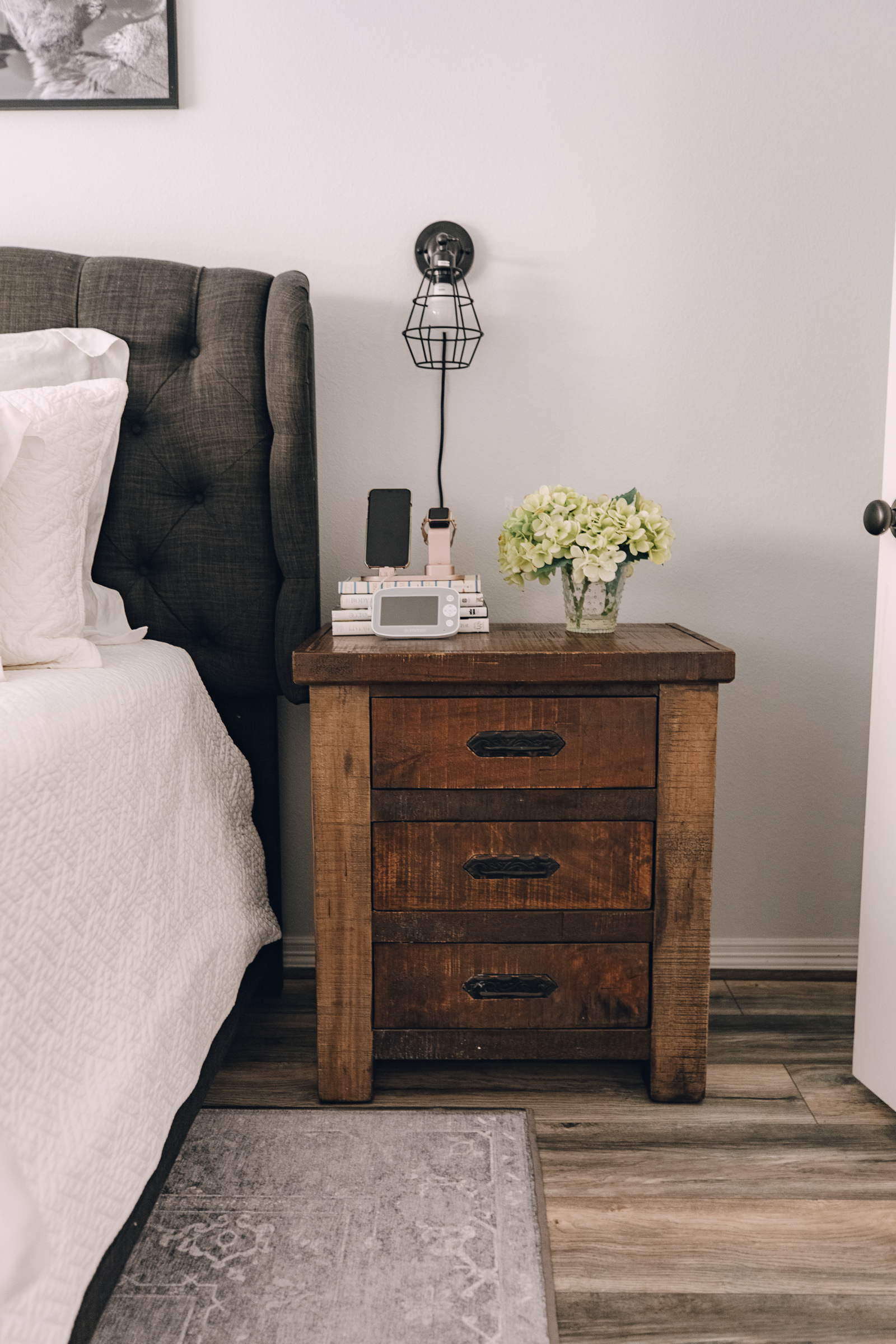 lifestyle blogger Elly Brown shares her minimalist nightstand decor in her master bedroom
