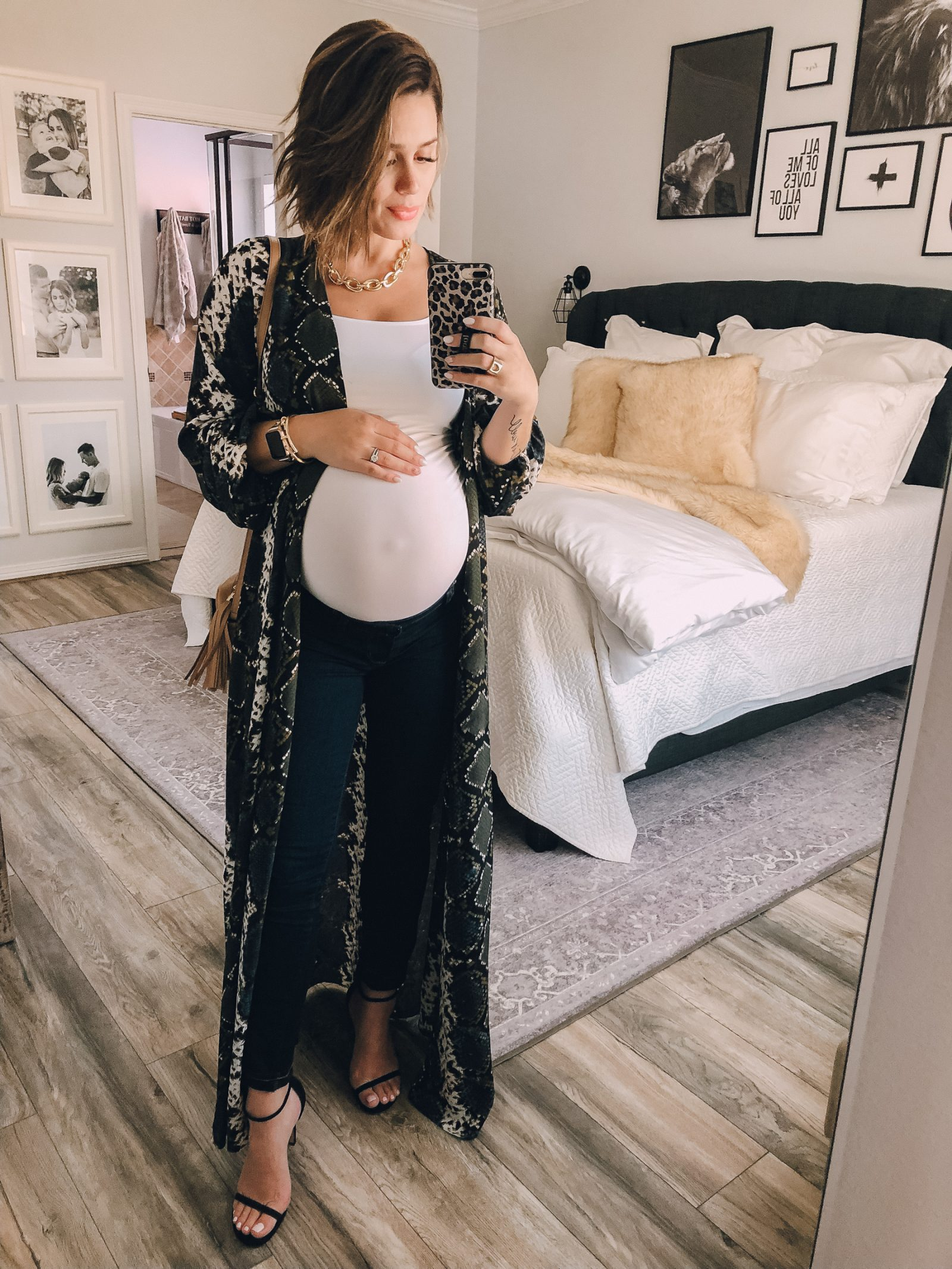 Fashion blogger Elly Brown wears a snake print duster from Buddy Love with skinny jeans and heels for a date night look