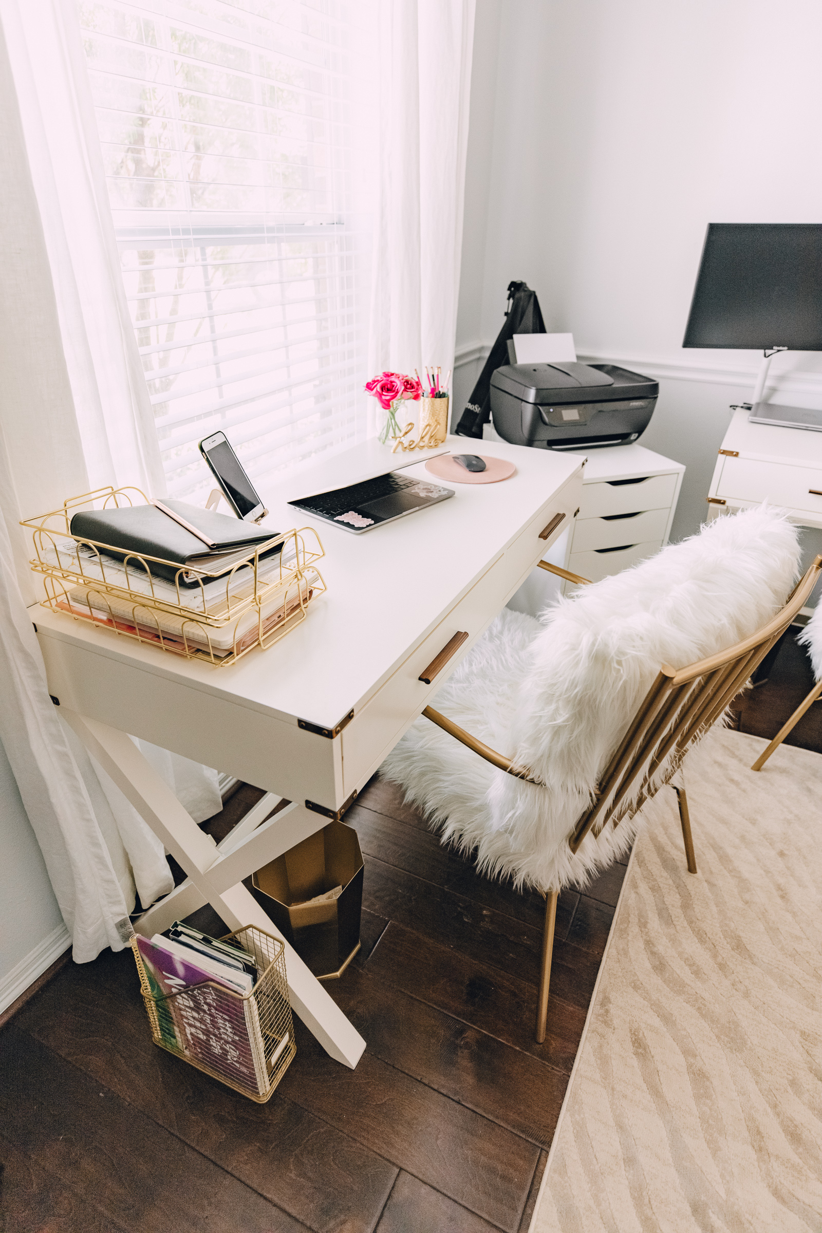 Houston blogger Elly Brown shares her shared office decor and office desk from CosmoLiving