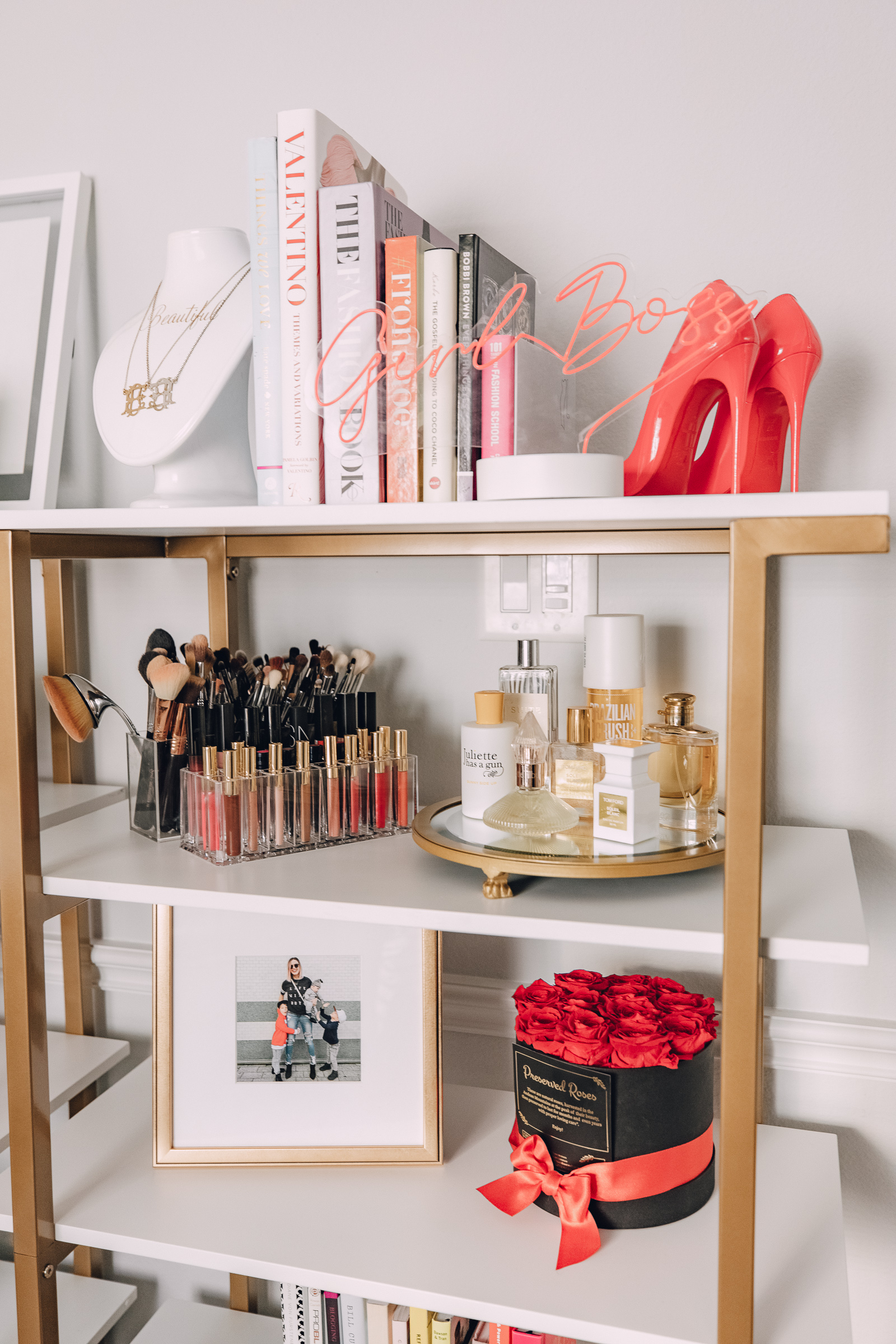 Houston blogger Elly Brown shares her Chic shared office decor and shelving decor from CosmoLiving