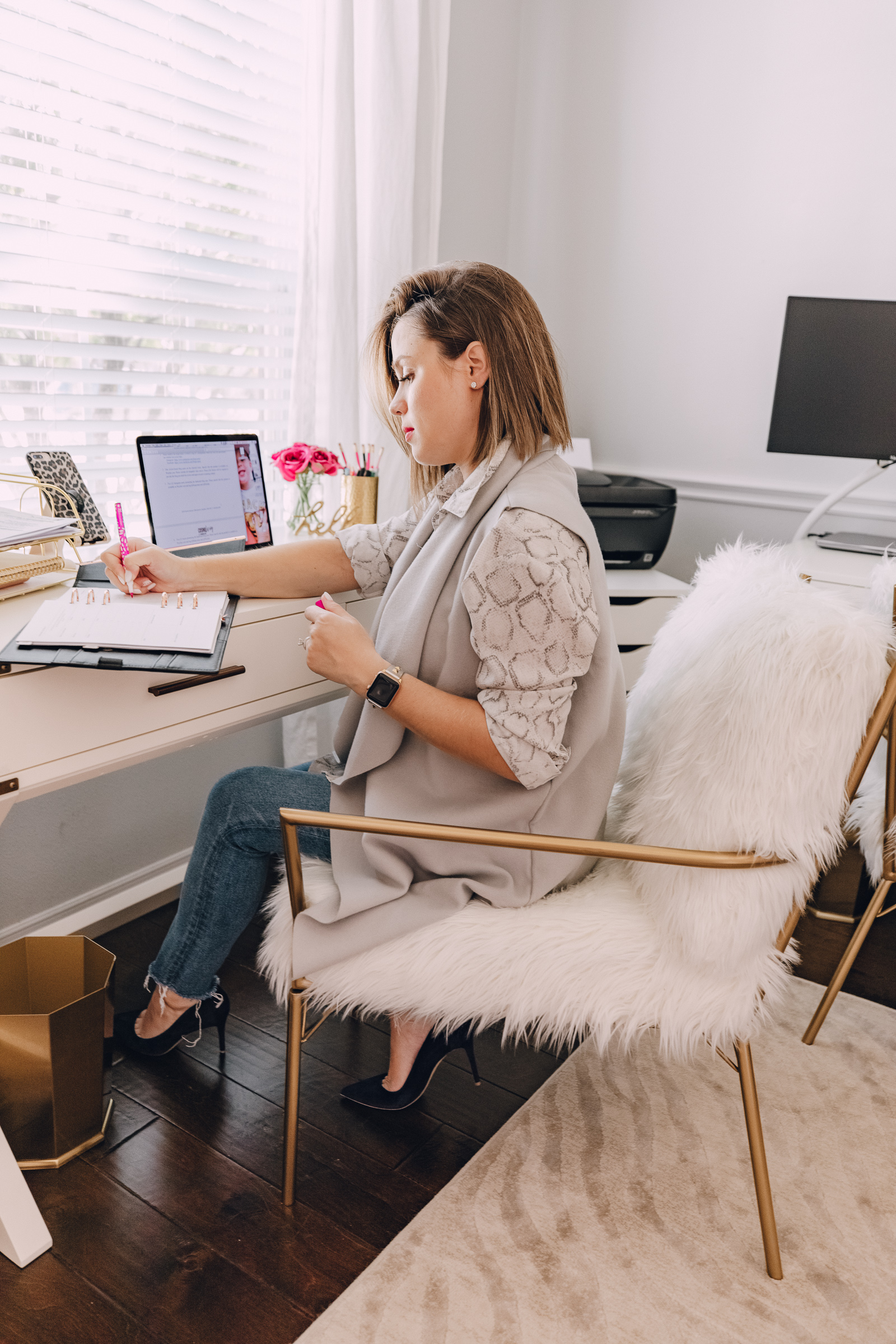 Houston blogger Elly Brown shares her shared office decor and office faux fur chair from CosmoLiving