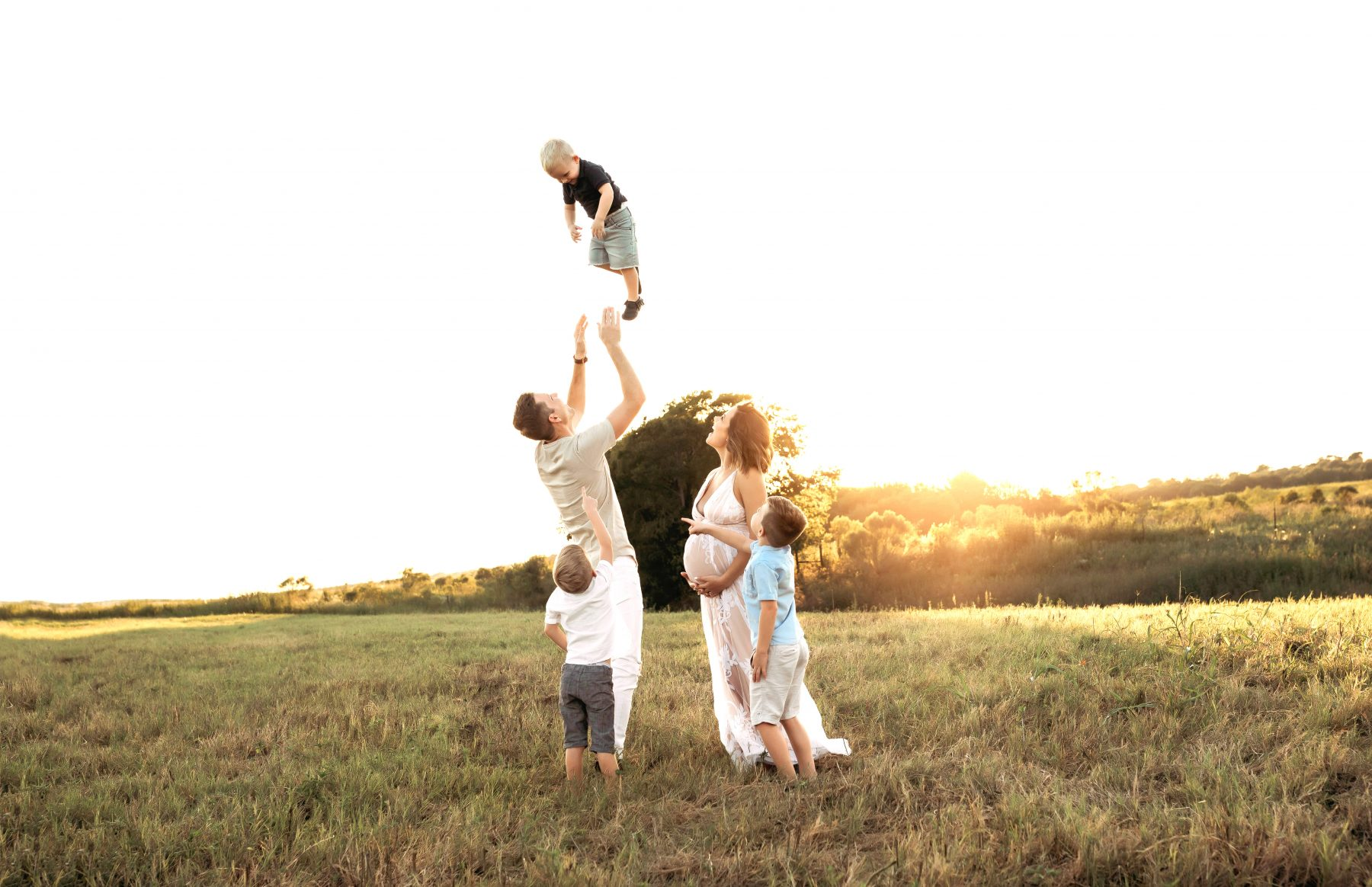 Houston lifestyle blogger Elly Brown shares her outdoor family maternity photos