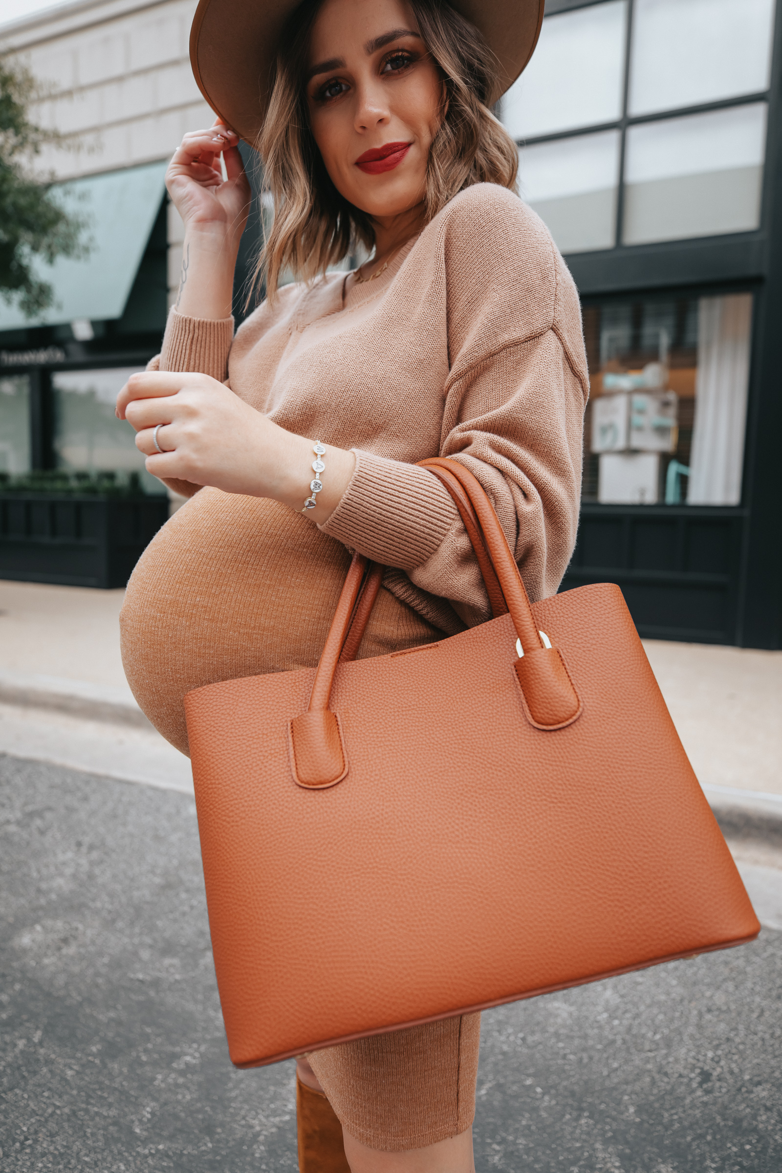 Houston Fashion blogger Elly Brown wears an Angela Roi Bag for a fall monochrome outfit