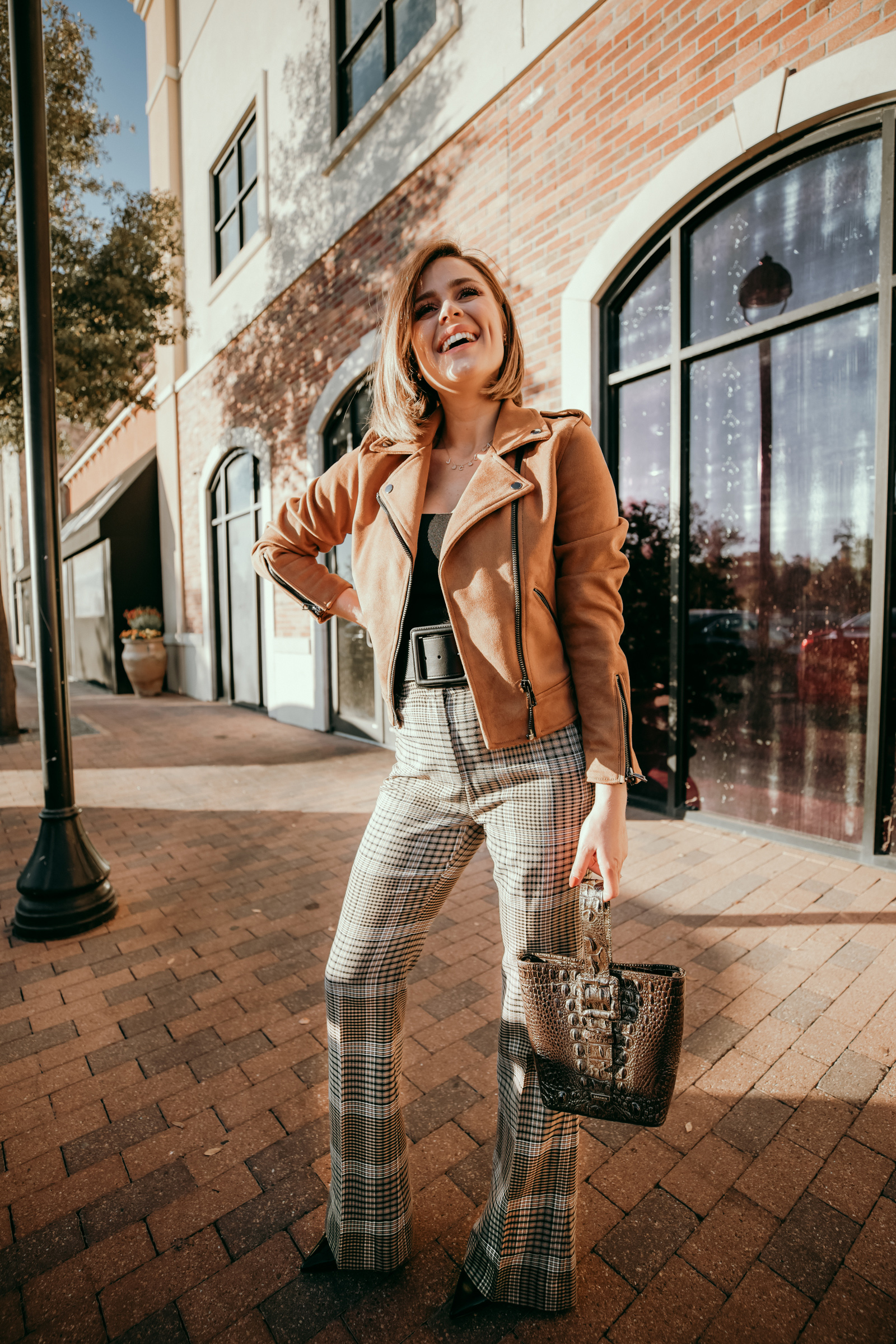 Houston blogger Elly Brown wears Halogen plaid pants with a suede motto jacket from Revolve