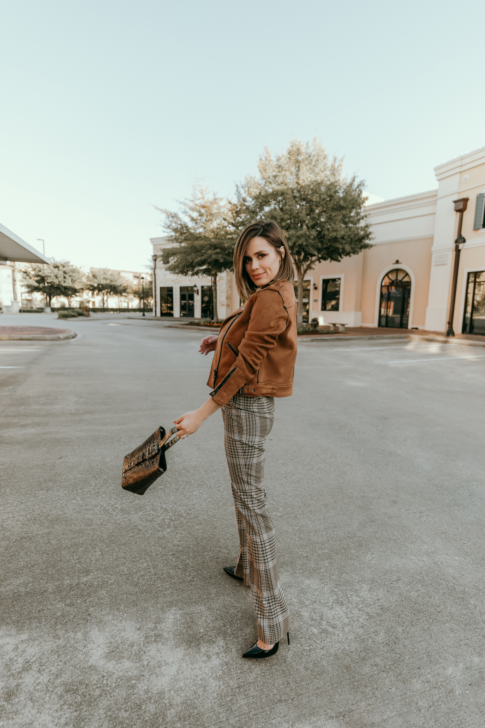 Houston blogger Elly Brown wears Halogen plaid pants with a suede motto jacket for a fall outfit