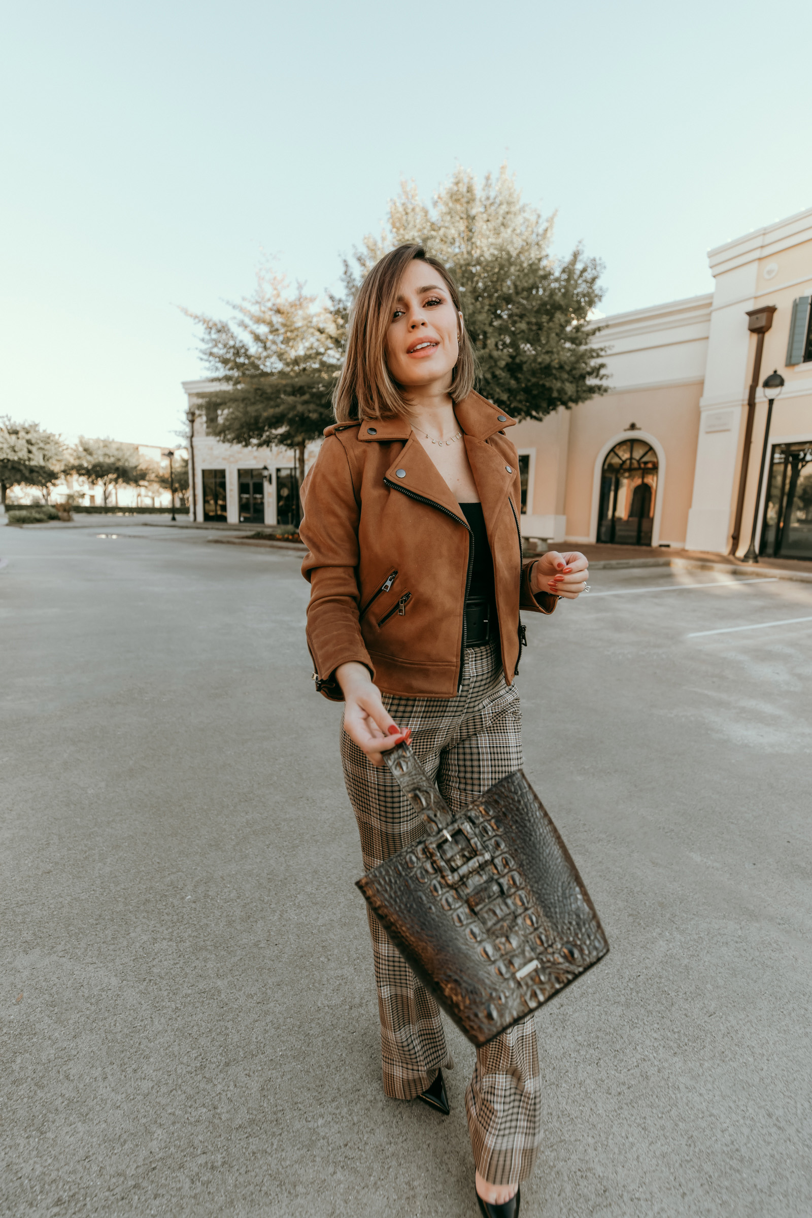 Houston blogger Elly Brown wears a suede jacket and Brahmin bag for a fall outfit