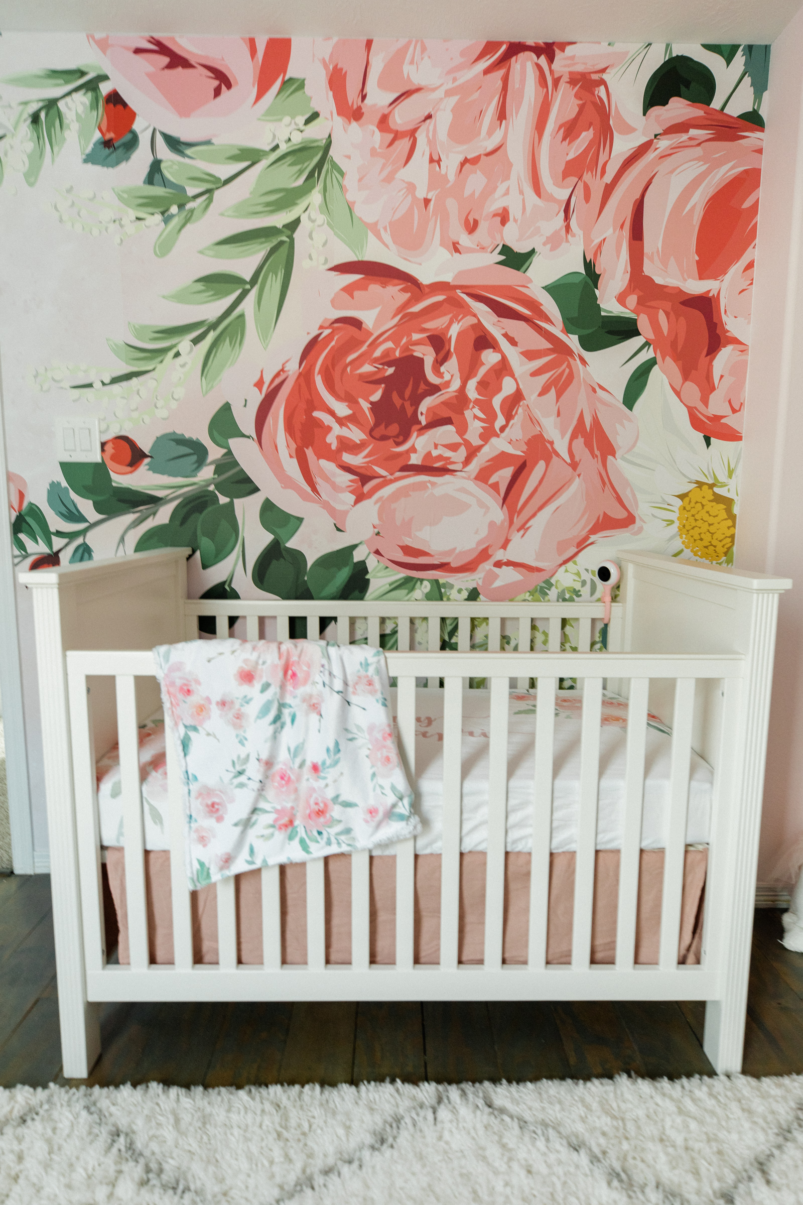 Houston lifestyle blogger Elly Brown shares the wallpaper mural in the baby girl nursery decor