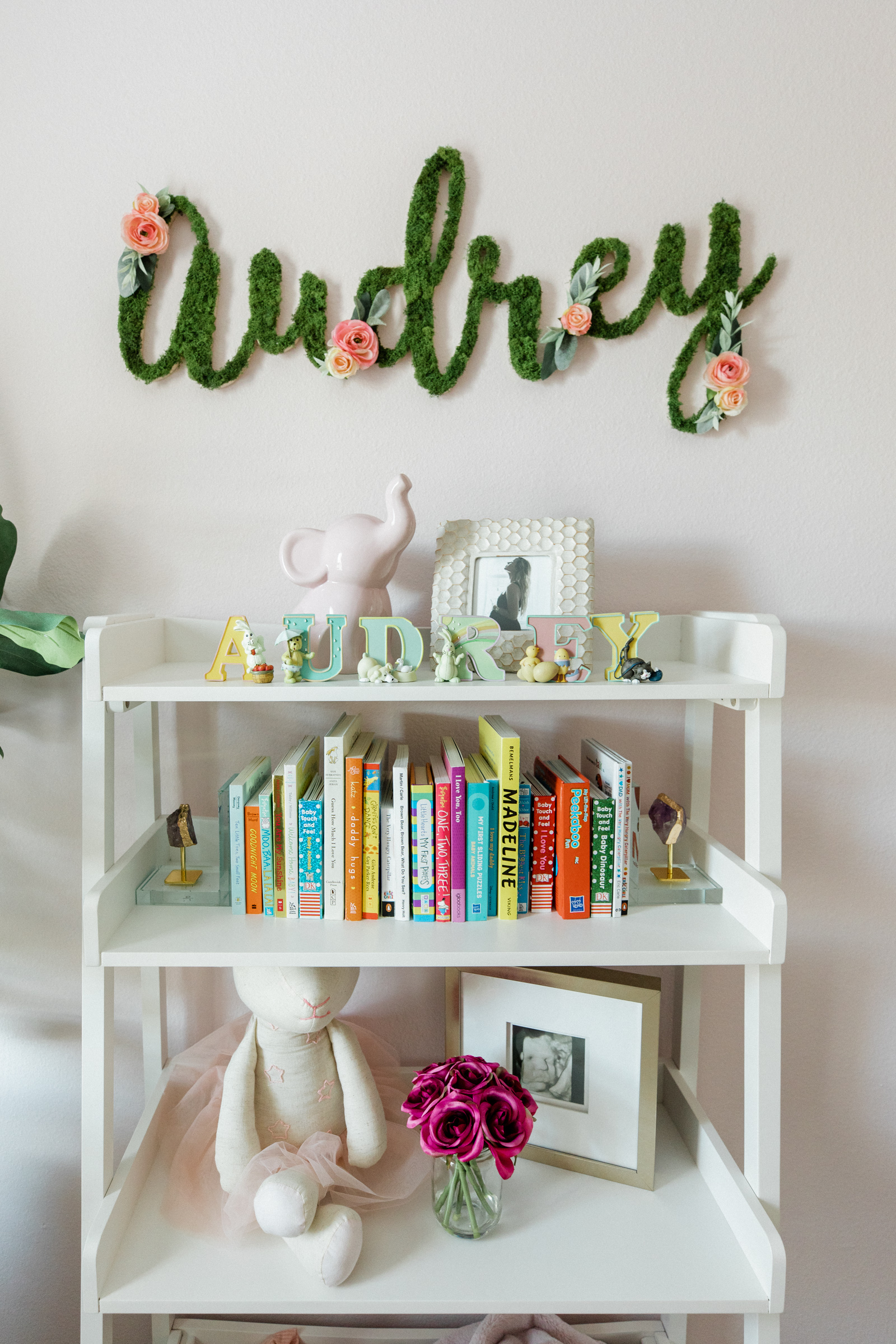 Houston lifestyle blogger Elly Brown shares bookcase decor ideas for baby girl nursery decor