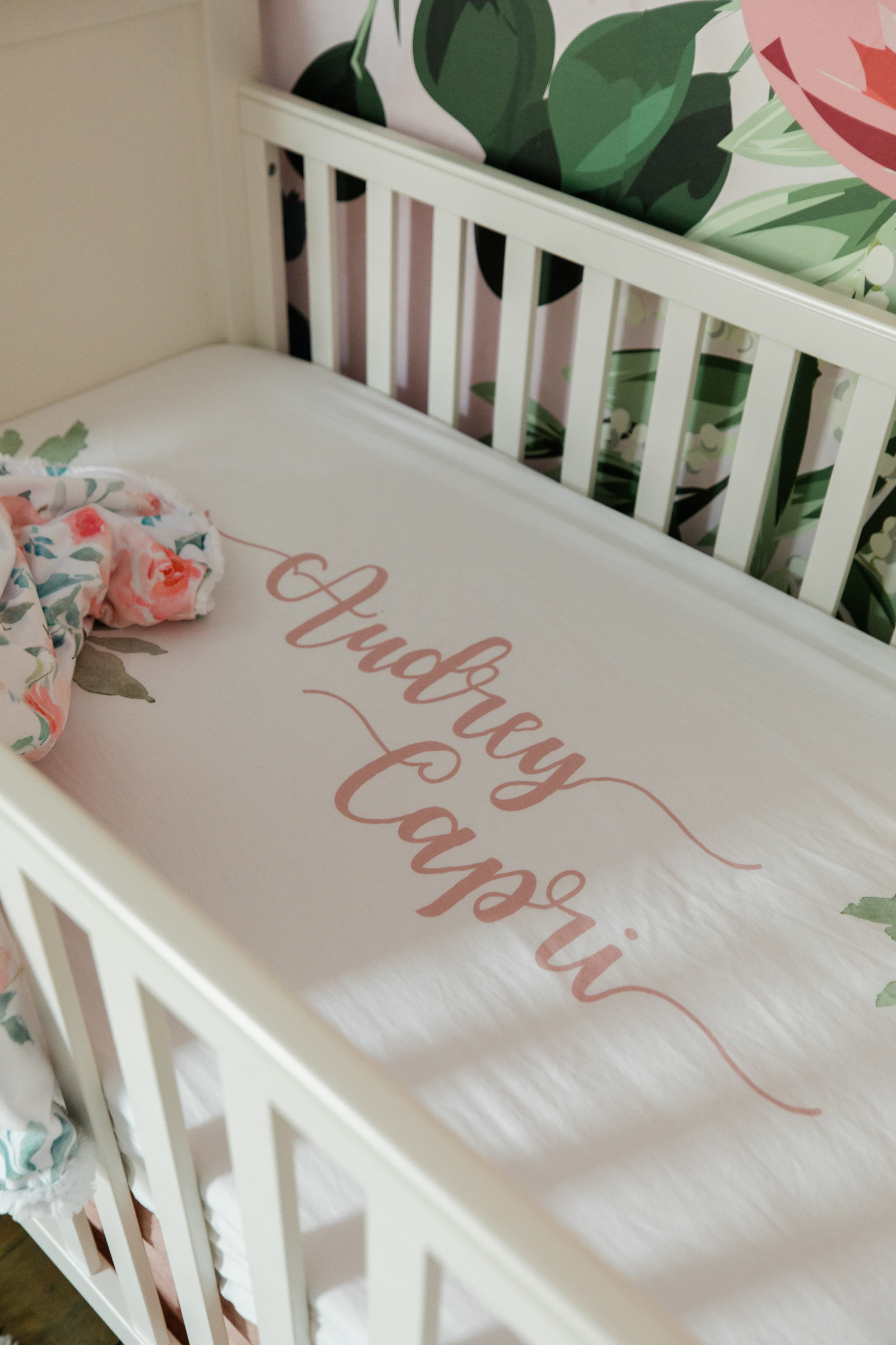 Houston lifestyle blogger Elly Brown reveals Audrey's custom crib bedding as a part of the nursery decor