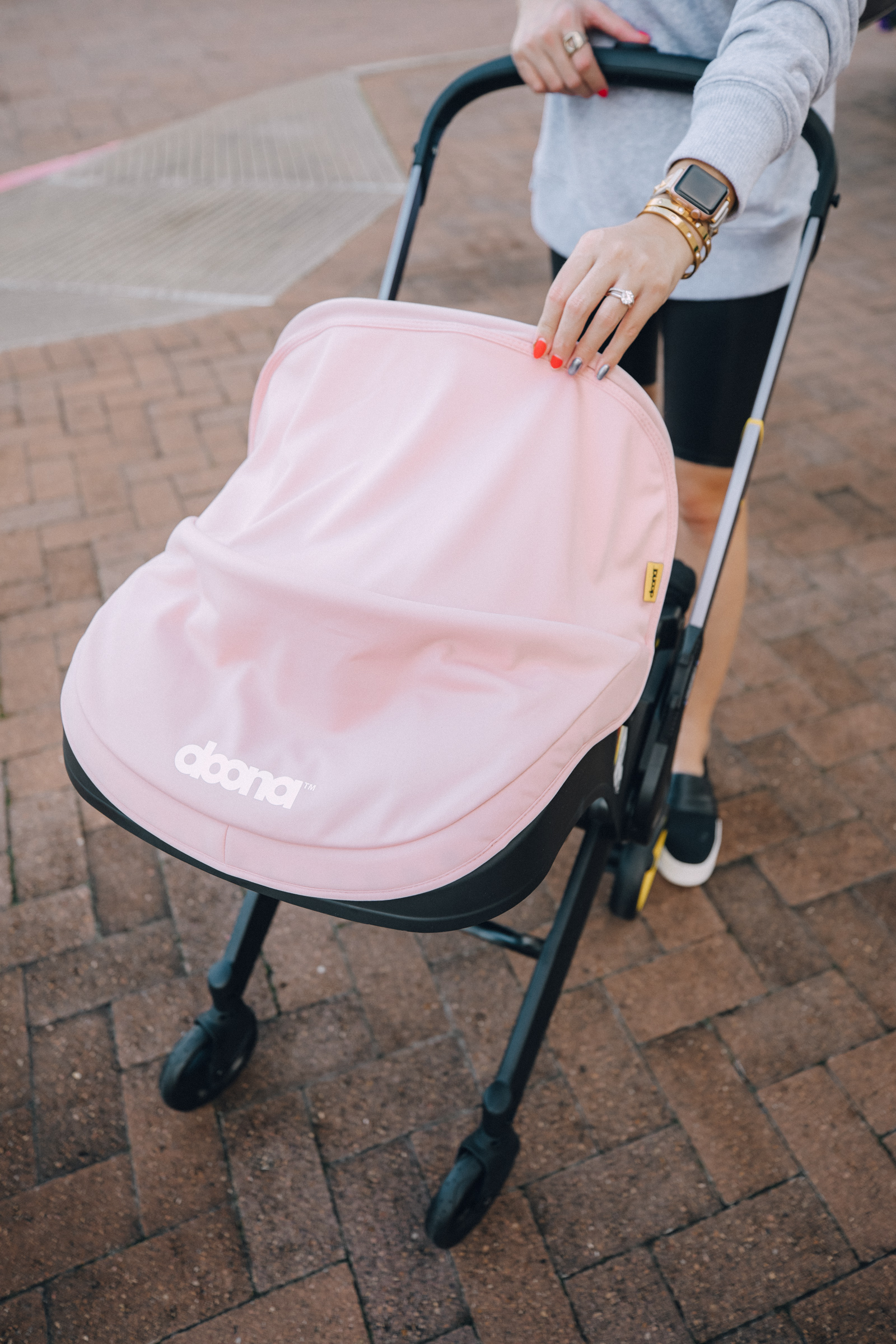 Houston lifestyle blogger Uptown with Elly Brown shares her Doona Stroller Review, and if it's really worth the $$$.