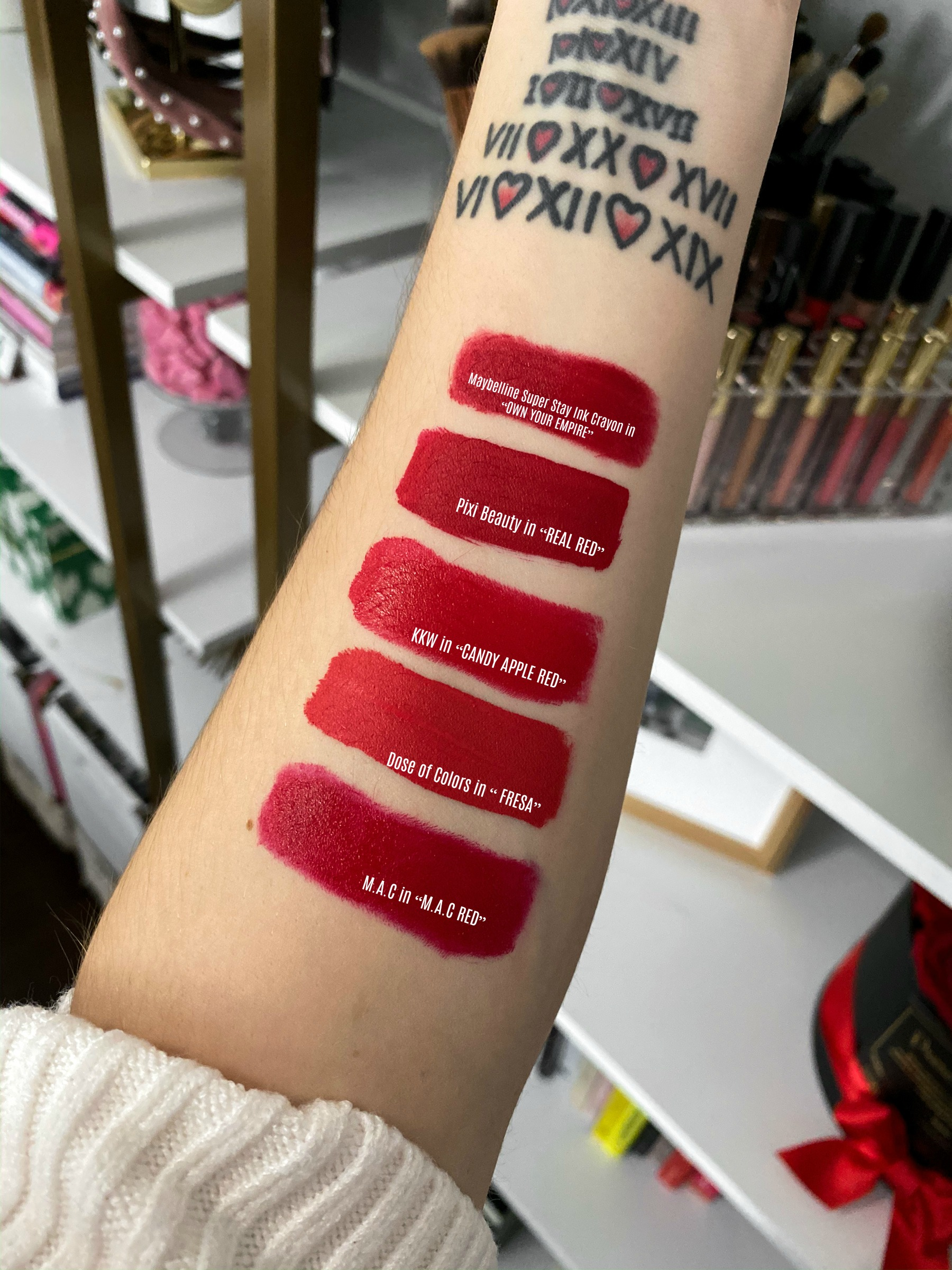 Looking for a GOOD red lipstick? Houston beauty blogger Elly Brown Shares 5 of her favorite Red Lipsticks Under $20.