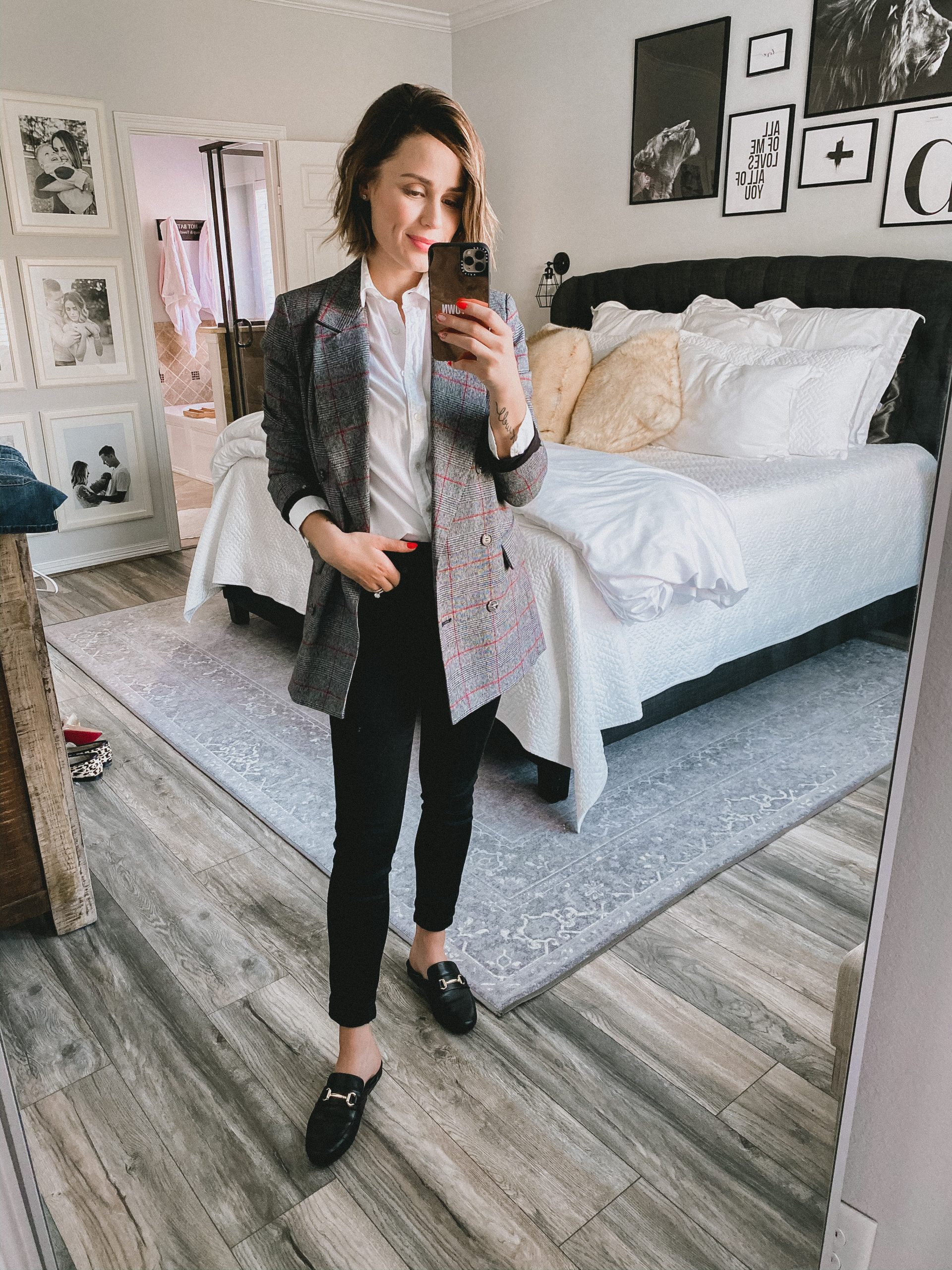Houston fashion blogger Elly Brown wears a button up top paired with a plaid blazer and Steve Madden mules