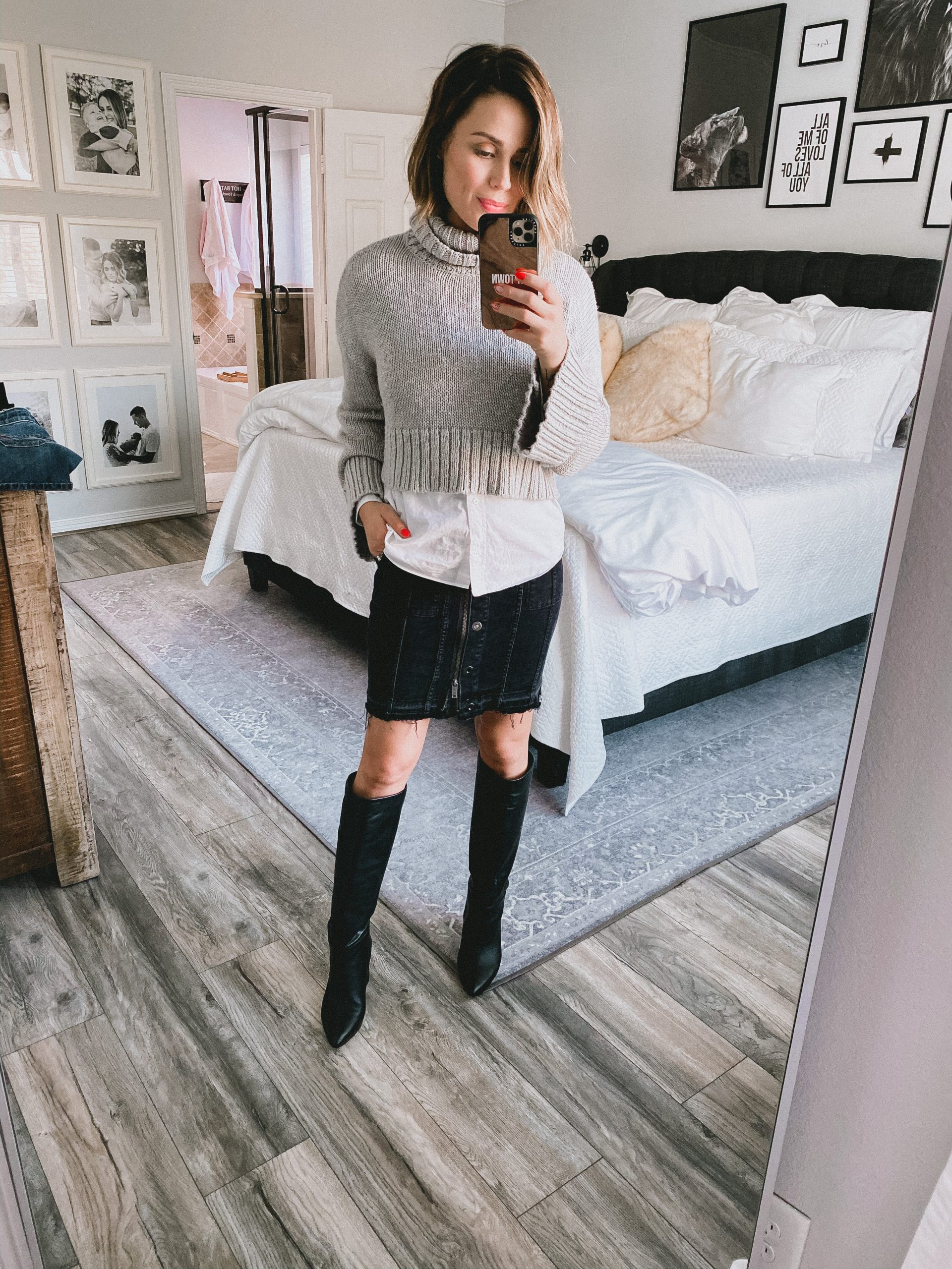 Houston fashion blogger Elly Brown wears a denim skirt with a Revolve sweater for a fall outfit