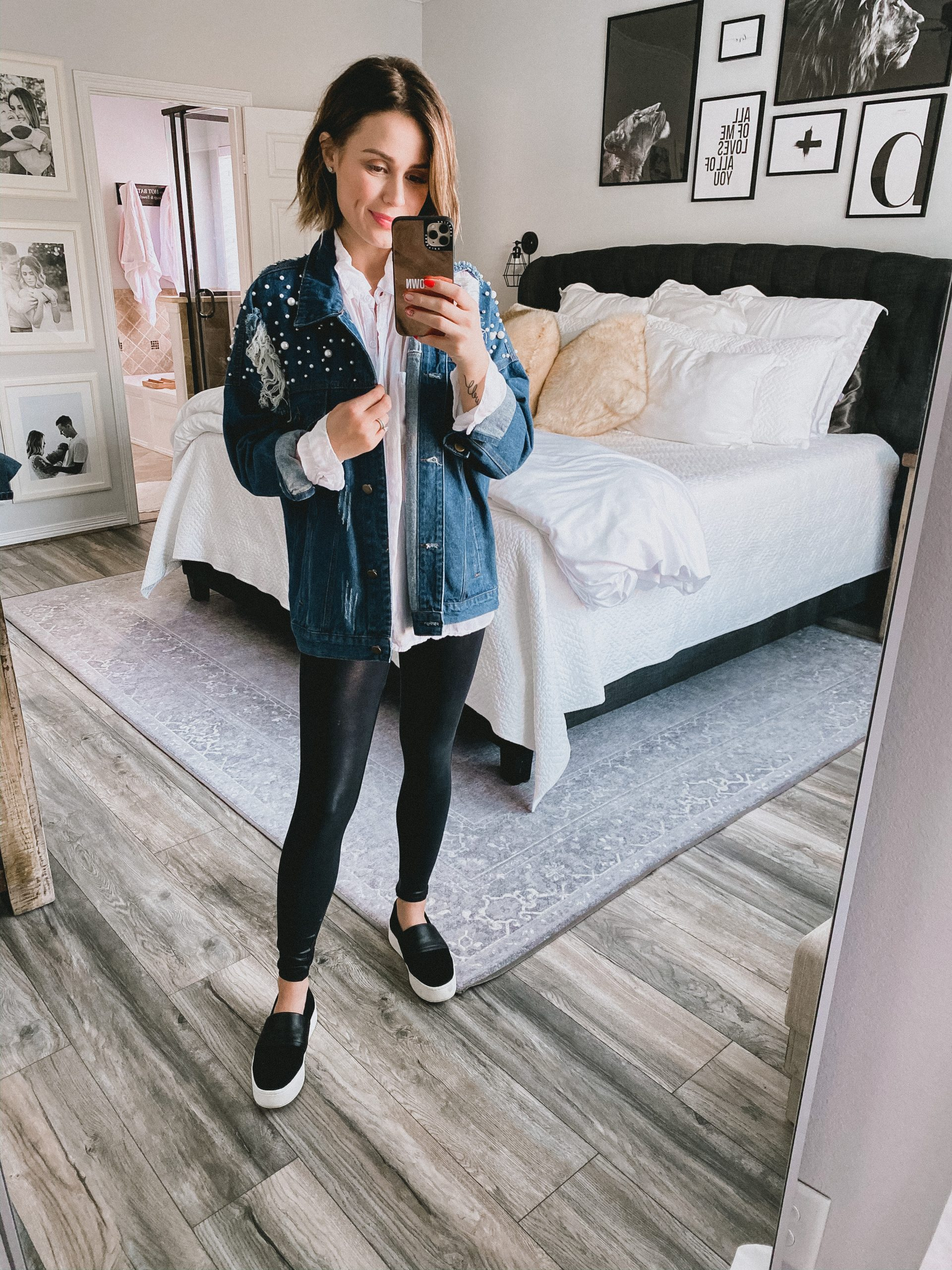 Houston fashion blogger Elly Brown wears leggings with an oversized boyfriend button up top
